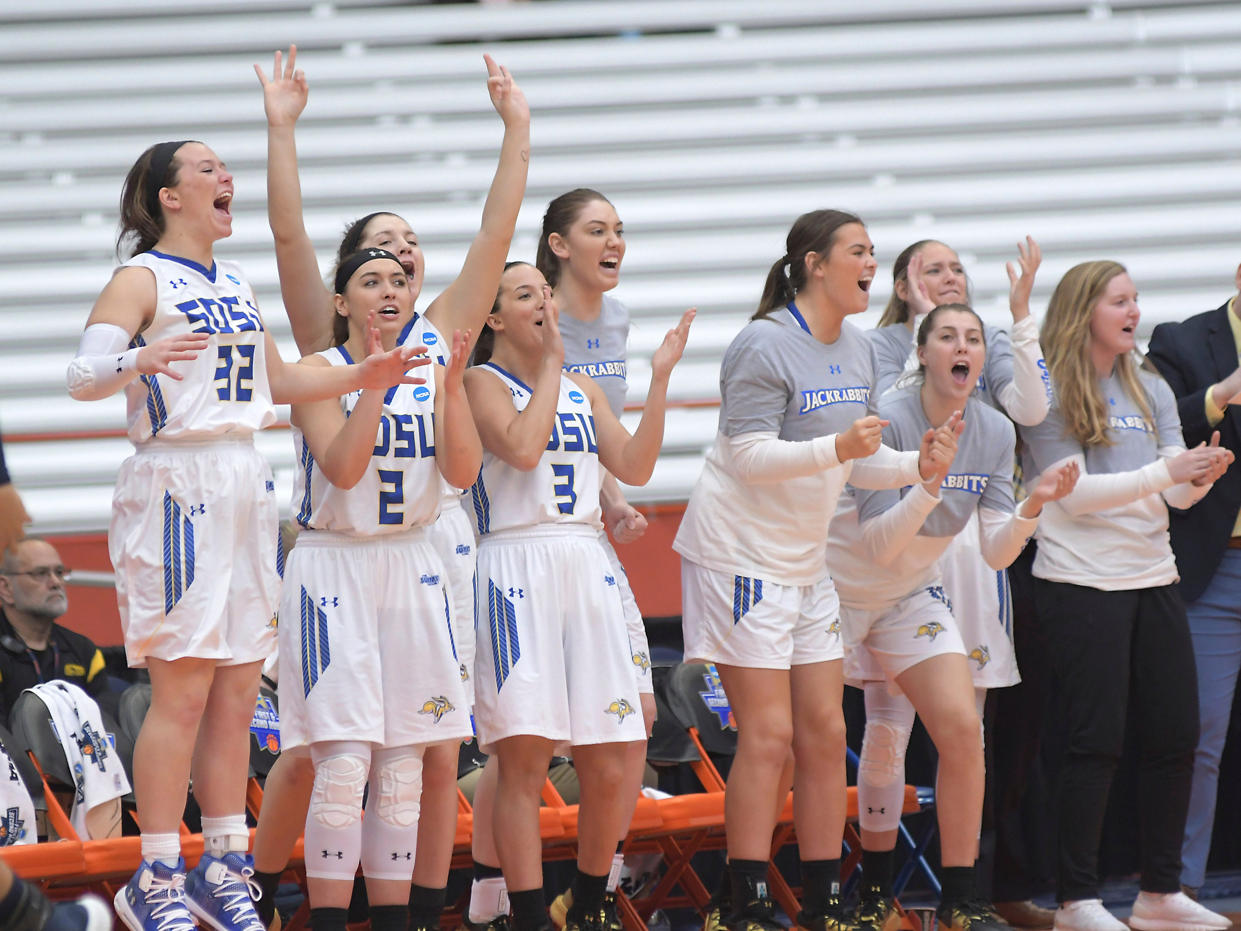 South Dakota State players cheer from the sideline during a first-round game against Quinnipiac in the NCAA women's college basketball tournament in Syracuse, N.Y., Saturday, March 23, 2019. (AP Photo/Heather Ainsworth)