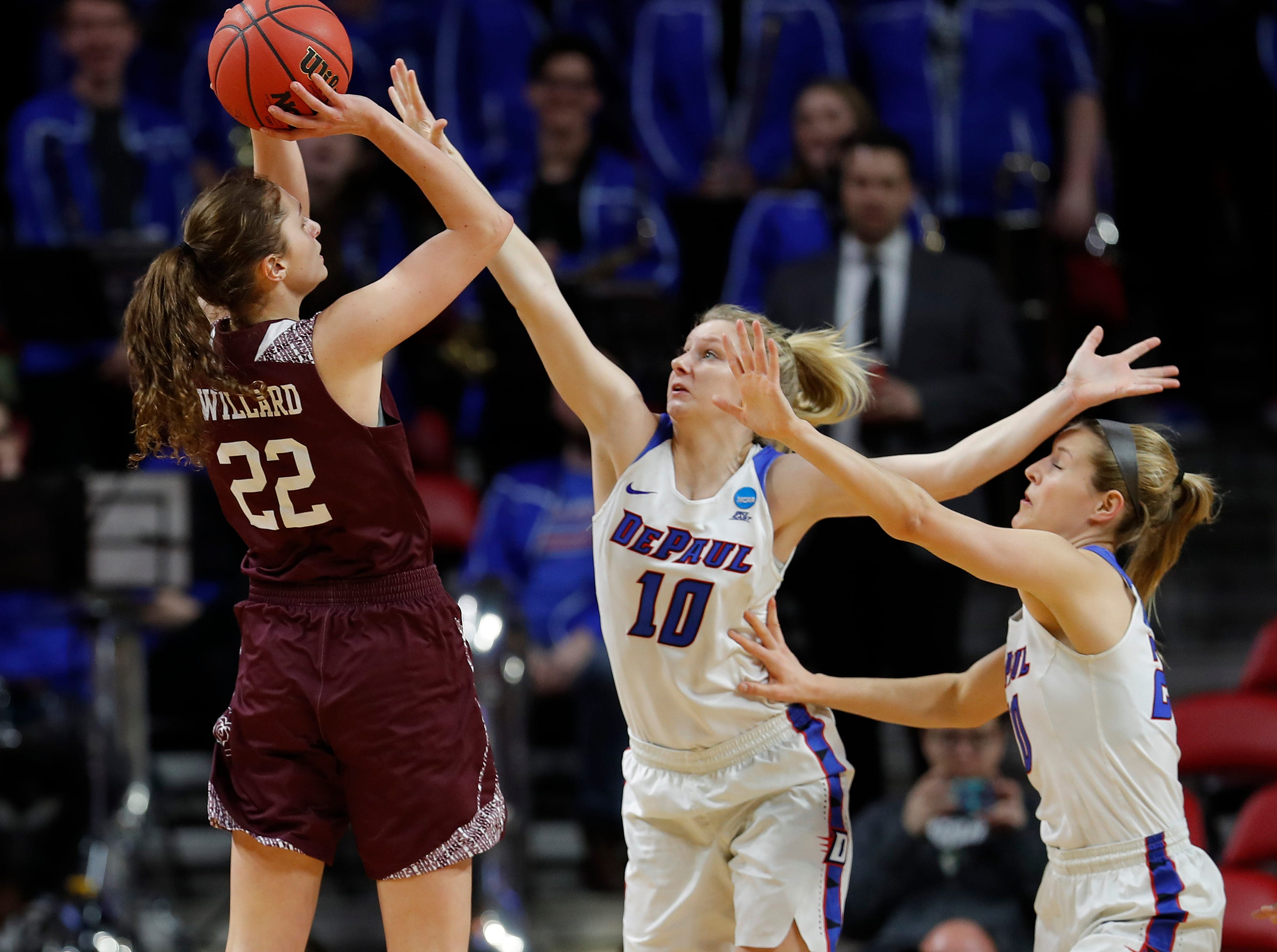 Missouri State guard Alexa Willard, left, drops back for a shot as DePaul guards Lexi Held, center, and Kelly Campbell, right, defend during the first half of a first round women's college basketball game in the NCAA Tournament, Saturday, March 23, 2019, in Ames, Iowa.