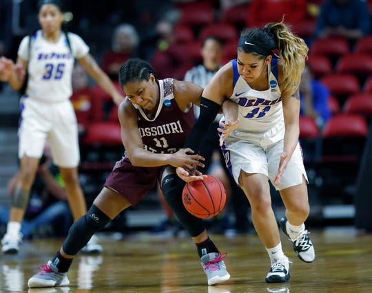 Missouri State guard Brice Calip, left, tries to control the ball as DePaul guard Sonya Morris, right, tries to steal during the first half of a first round women's college basketball game in the NCAA Tournament, Saturday, March 23, 2019, in Ames, Iowa.