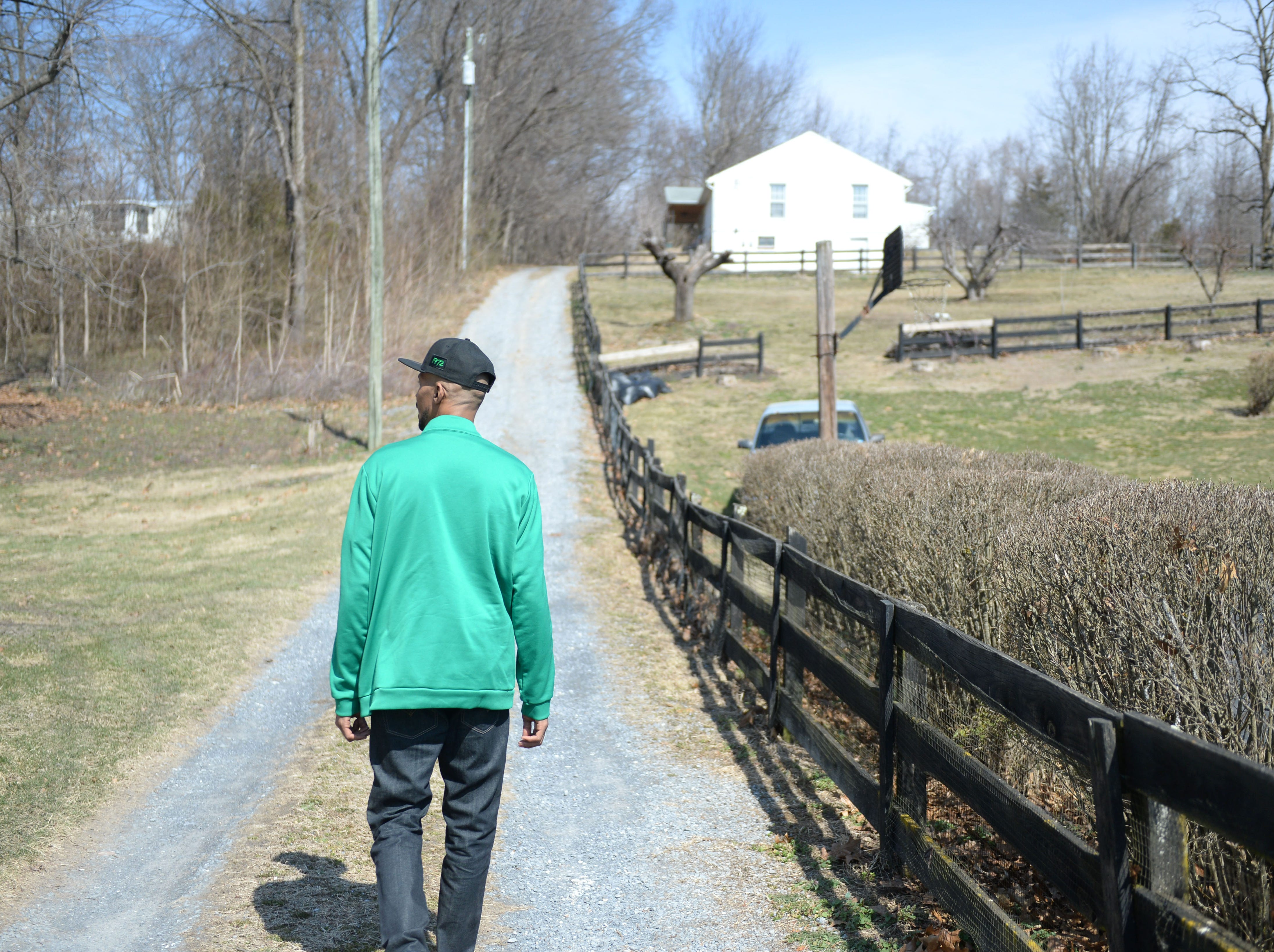 Keith Scott walks up the driveway of the house where he used to live on Buttermilk Spring Road in Augusta County.