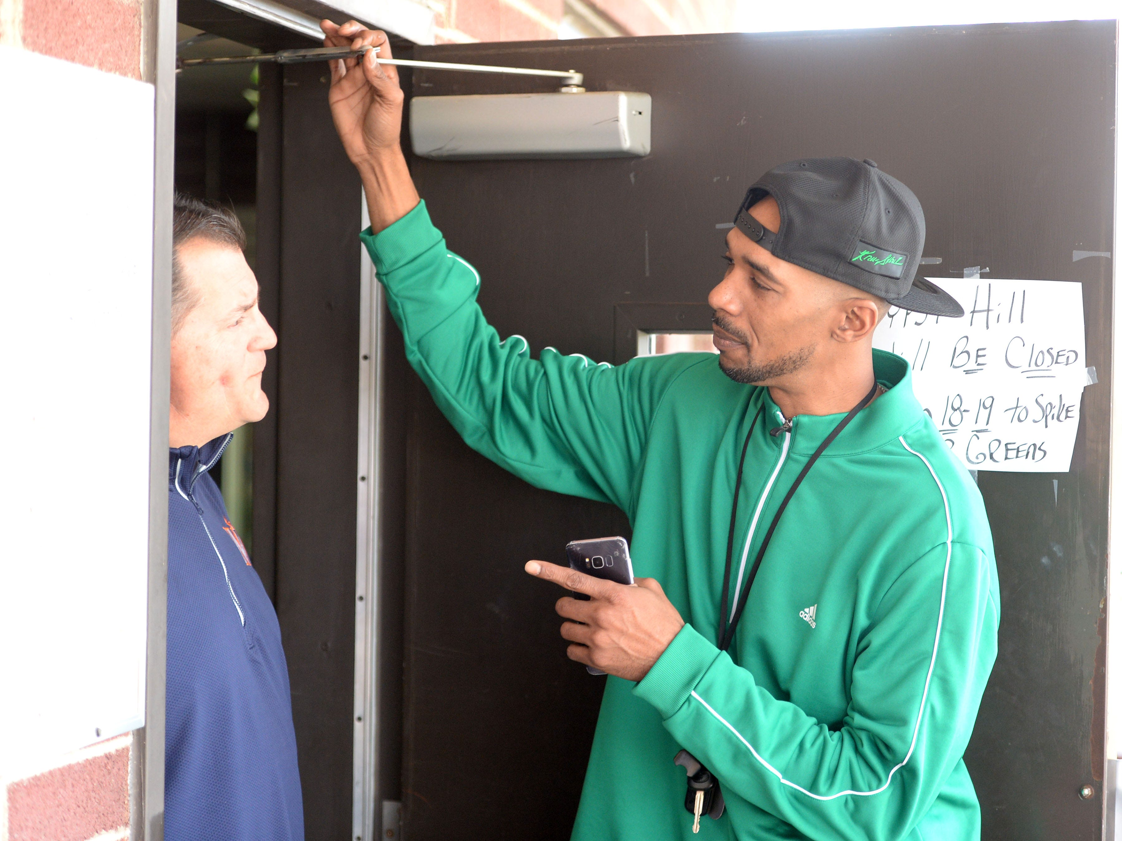 Keith Scott talks with Gypsy Hill golf pro Wes Allred on a recent Thursday morning in March. Scott is holding  golf tournament in July to promote his Kru-Shal sportswear company.
