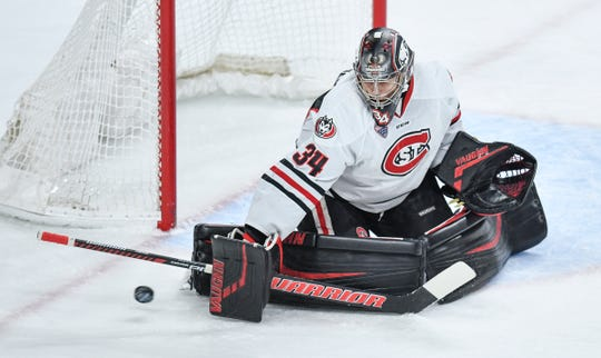 St. Cloud State's David Hrenak makes a save during the NCHC Frozen Faceoff semifinals Friday, March 22, at the Xcel Energy Center in St. Paul.