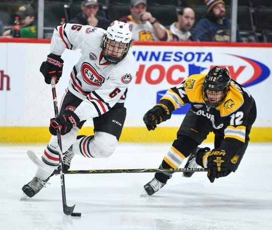 St. Cloud State's Like Jaycox skates past Ben Copeland of Colorado College during the NCHC Frozen Faceoff semifinals Friday, March 22, at the Xcel Energy Center in St. Paul.