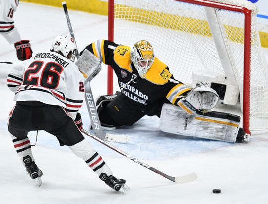 Easton Brodzinski takes a shot on Colorado College goaltender Elex Leclerc during the NCHC Frozen Faceoff semifinals Friday, March 22, at the Xcel Energy Center in St. Paul.