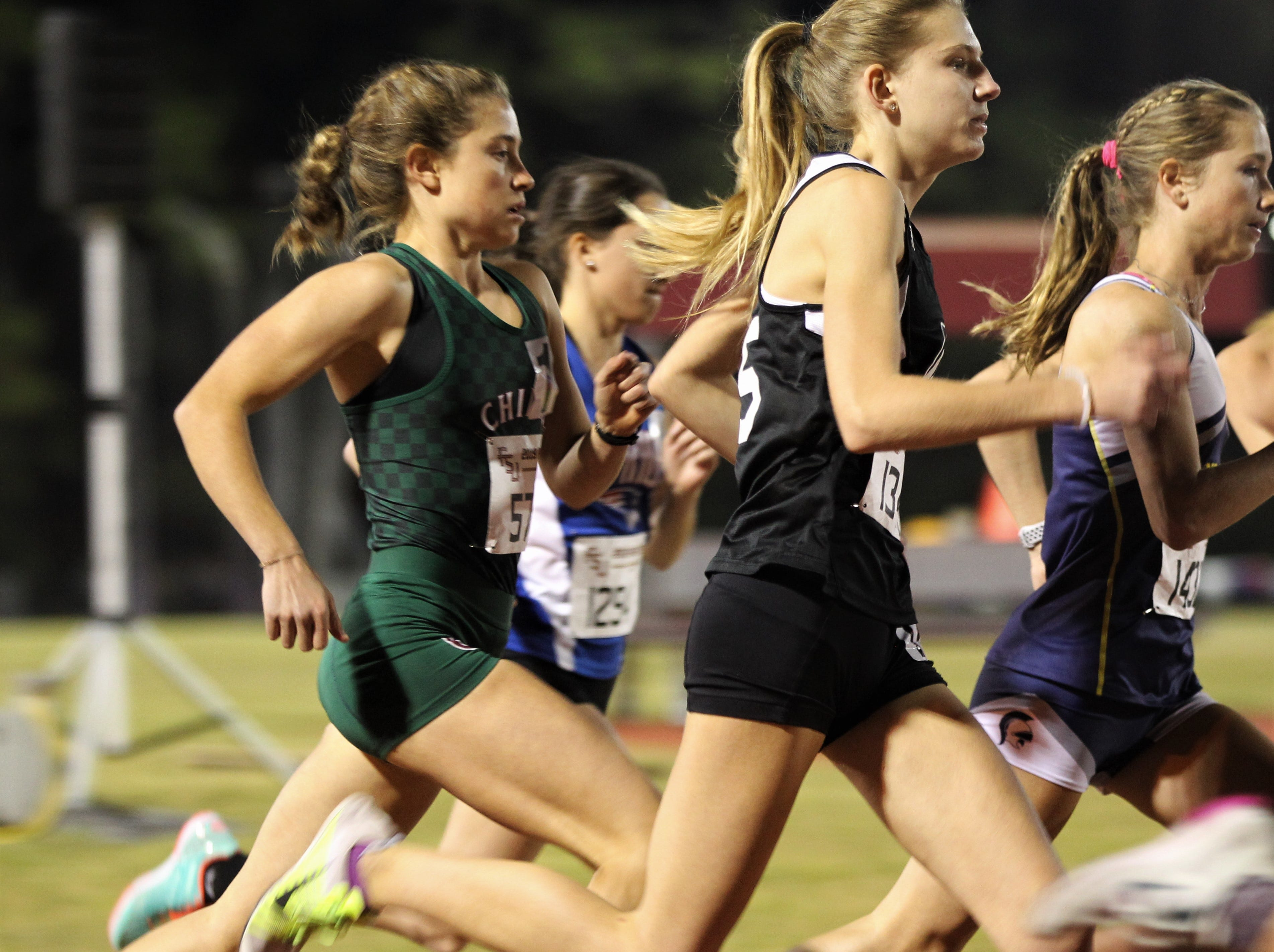 Chiles junior Alyson Churchill competes in the 3200-meter invitational race during the 40th annual FSU Relays at Mike Long Track on Friday night, March 22, 2019.