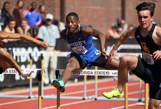 Godby junior GeKelvion Baldwin runs the 110-meter high hurdles during the 40th annual FSU Relays at Mike Long Track on Saturday, March 23, 2019.