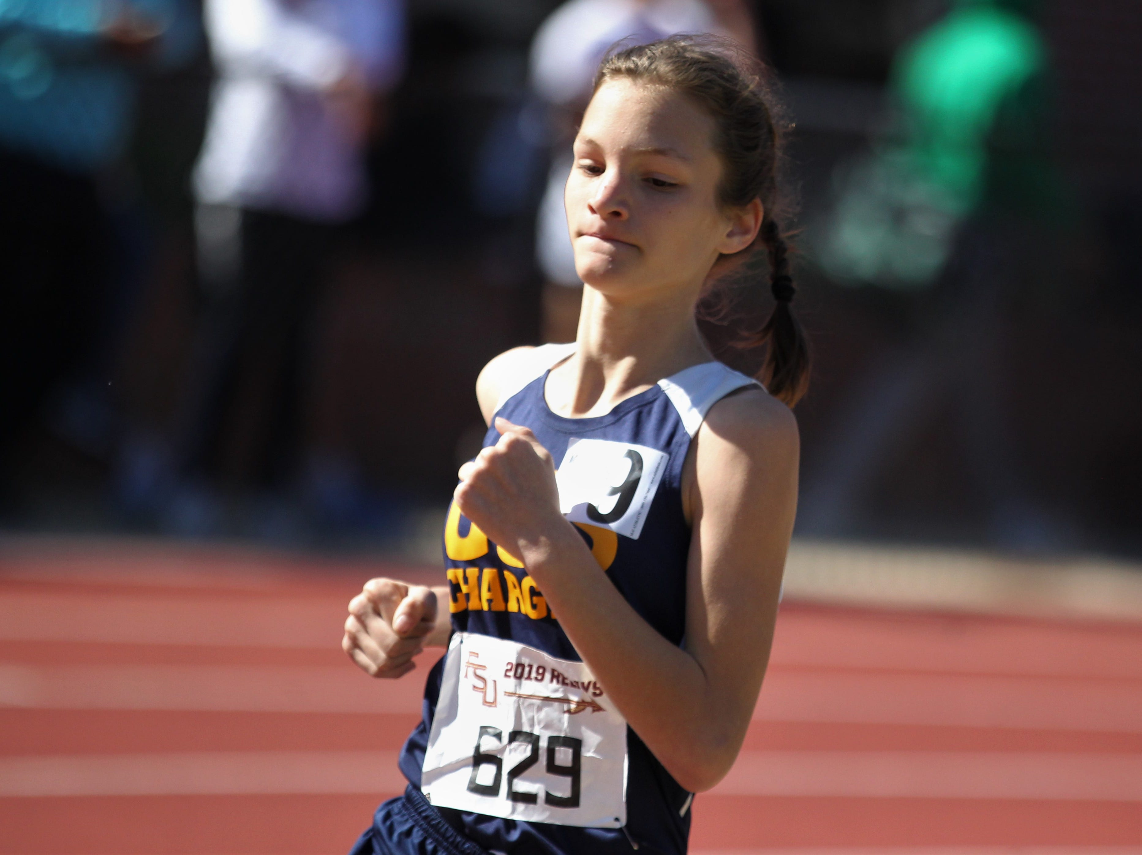 Community Christian seventh-grader Sarah Tyschen runs the 1600 during the 40th annual FSU Relays at Mike Long Track on Saturday, March 23, 2019.