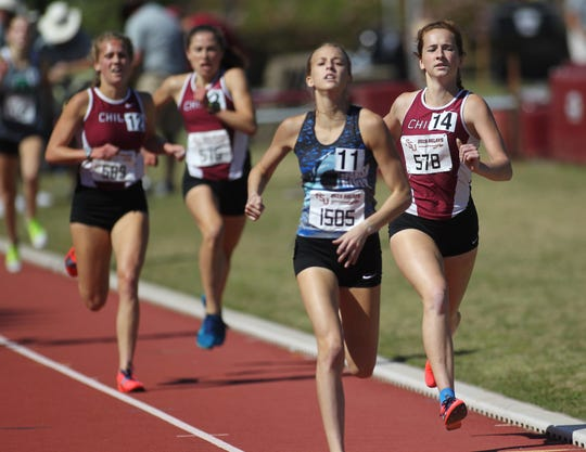 Chiles senior Emily Culley leads teammates Caitlin Wilkey and Alyson Churchill into the finish of the 1600 invitational race at Saturday's FSU Relays. All three Timberwolves distance runners ran under 5:00.
