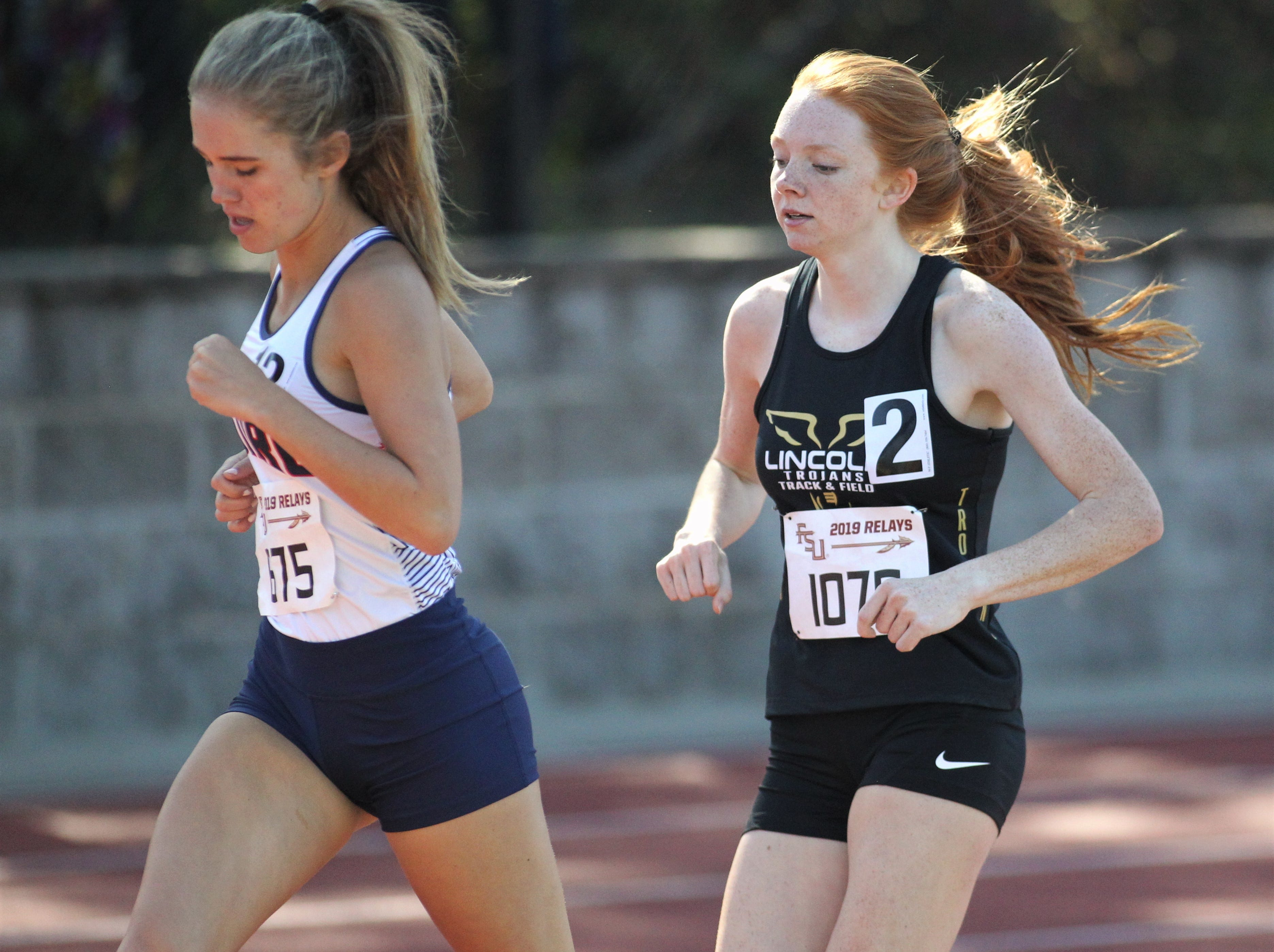 Lincoln sophomore Lauren Whittier runs the 1600 during the 40th annual FSU Relays at Mike Long Track on Saturday, March 23, 2019.