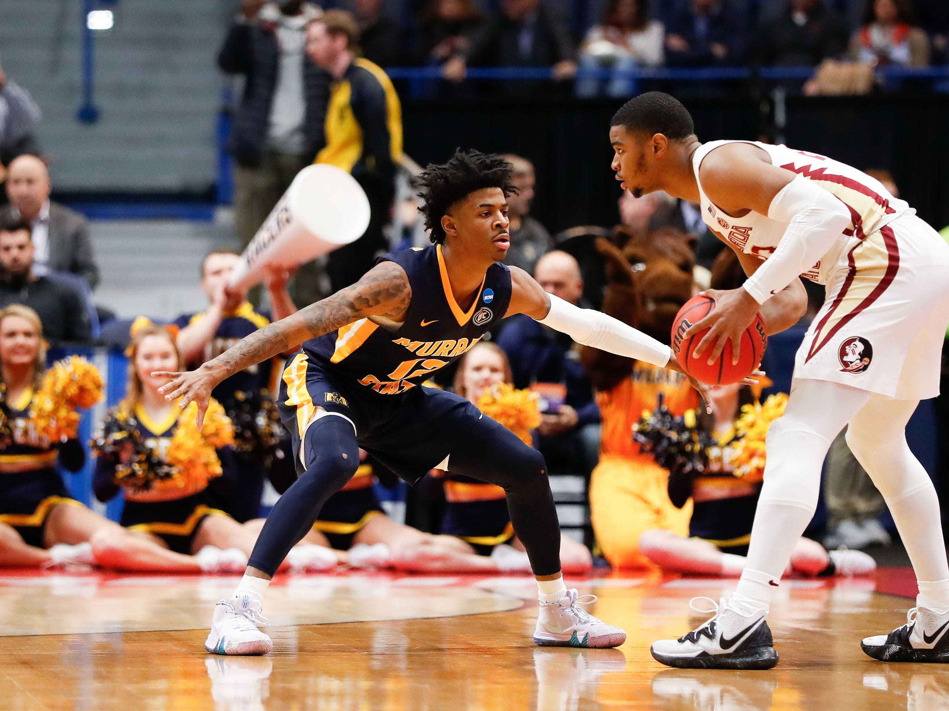 Mar 23, 2019; Hartford, CT, USA; Murray State Racers guard Ja Morant (12) defends Florida State Seminoles guard M.J. Walker (23) during the first half of a game in the second round of the 2019 NCAA Tournament at XL Center. Mandatory Credit: David Butler II-USA TODAY Sports