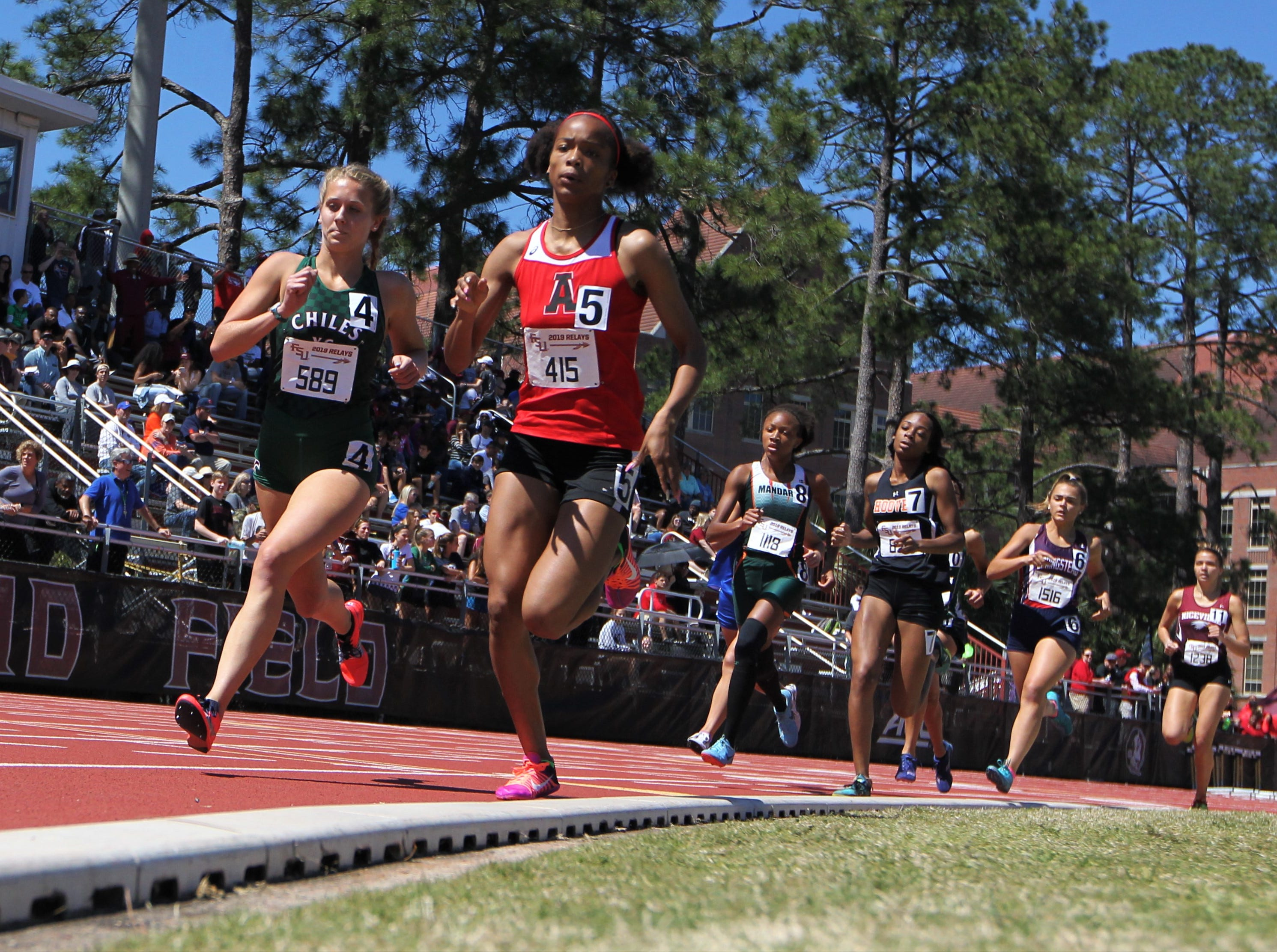 Chiles junior Caitlin Wilkey races next to Alexander's Jazzmin Taylor in the 800-meter run during the FSU Relays at Mike Long Track on Friday, March 22, 2019.