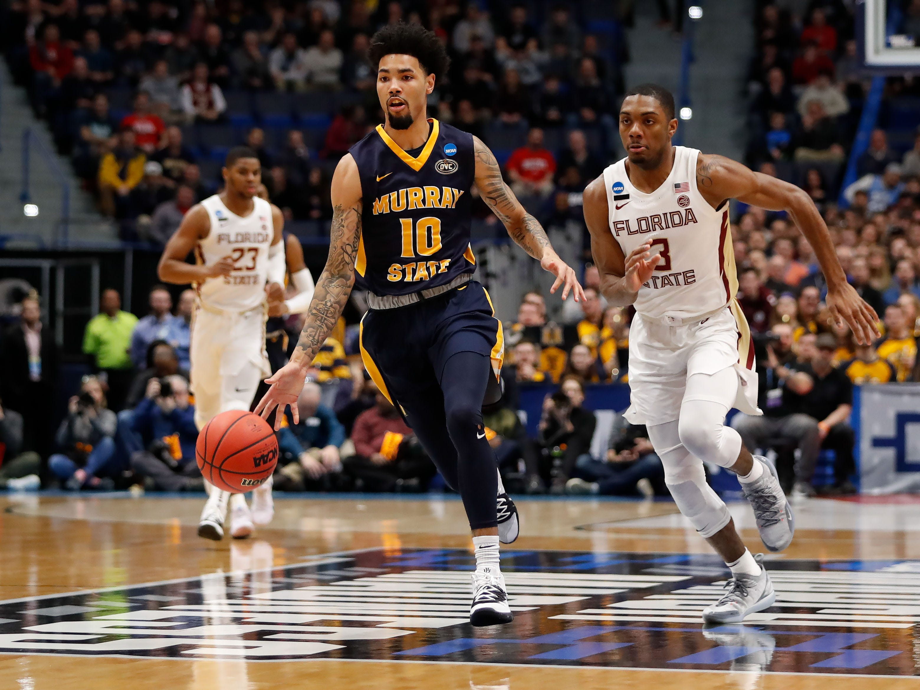 Mar 23, 2019; Hartford, CT, USA; Murray State Racers guard Tevin Brown (10) dribbles the ball up the court in front of Florida State Seminoles guard Trent Forrest (3) during the first half of a game in the second round of the 2019 NCAA Tournament at XL Center. Mandatory Credit: David Butler II-USA TODAY Sports