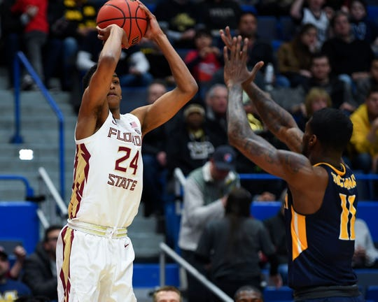 Mar 23, 2019; Hartford, CT, USA; Florida State Seminoles guard Devin Vassell (24) attempts a three point shot past Murray State Racers guard Shaq Buchanan (11) during the first half of a game in the second round of the 2019 NCAA Tournament at XL Center. Mandatory Credit: Robert Deutsch-USA TODAY Sports