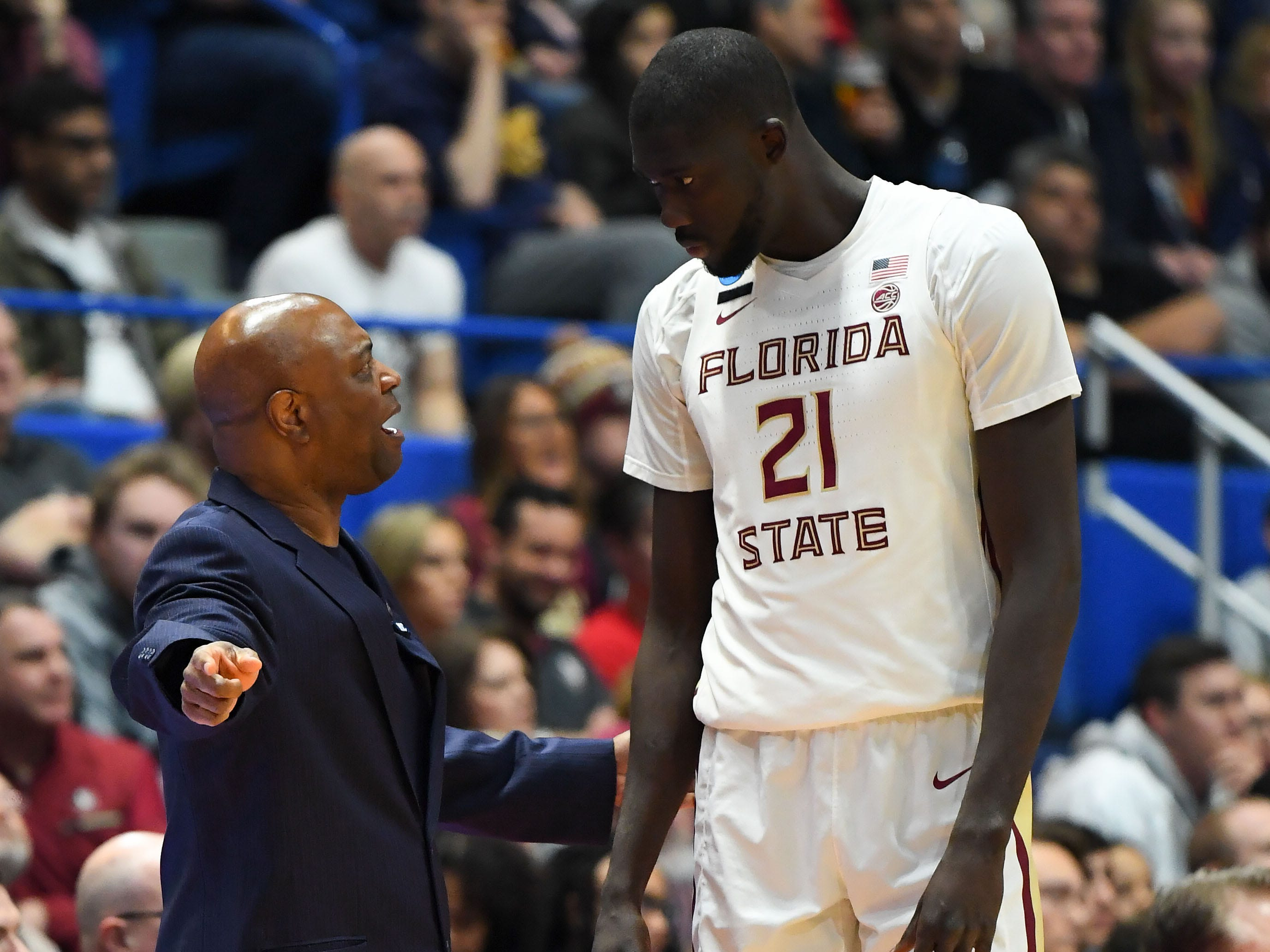 Mar 23, 2019; Hartford, CT, USA; Florida State Seminoles head coach Leonard Hamilton talks with center Christ Koumadje (21) during the first half of a game against the Murray State Racers in the second round of the 2019 NCAA Tournament at XL Center. Mandatory Credit: Robert Deutsch-USA TODAY Sports