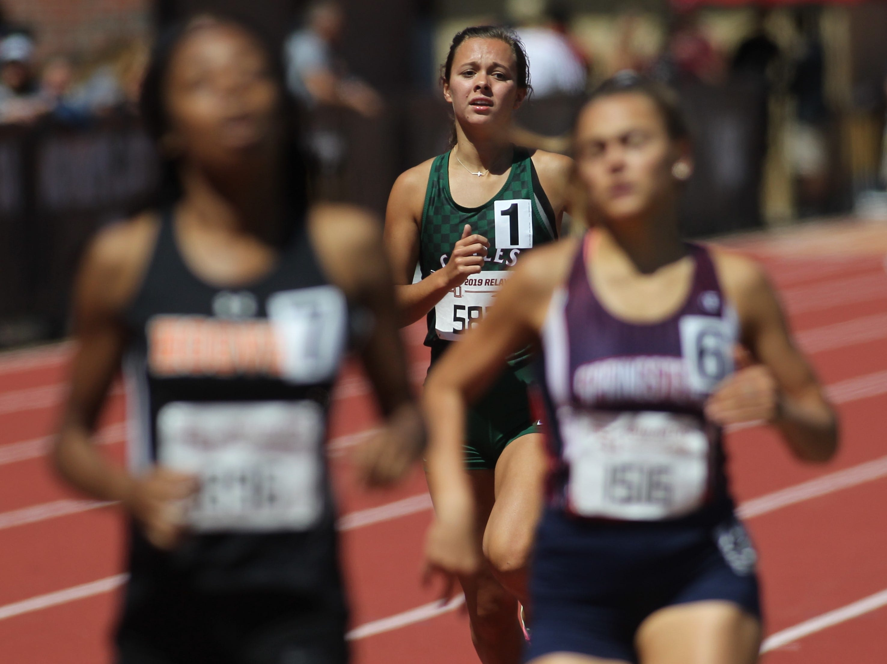 Chiles senior Olivia Miller competes in the 800-meter run during the FSU Relays at Mike Long Track on Friday, March 22, 2019.