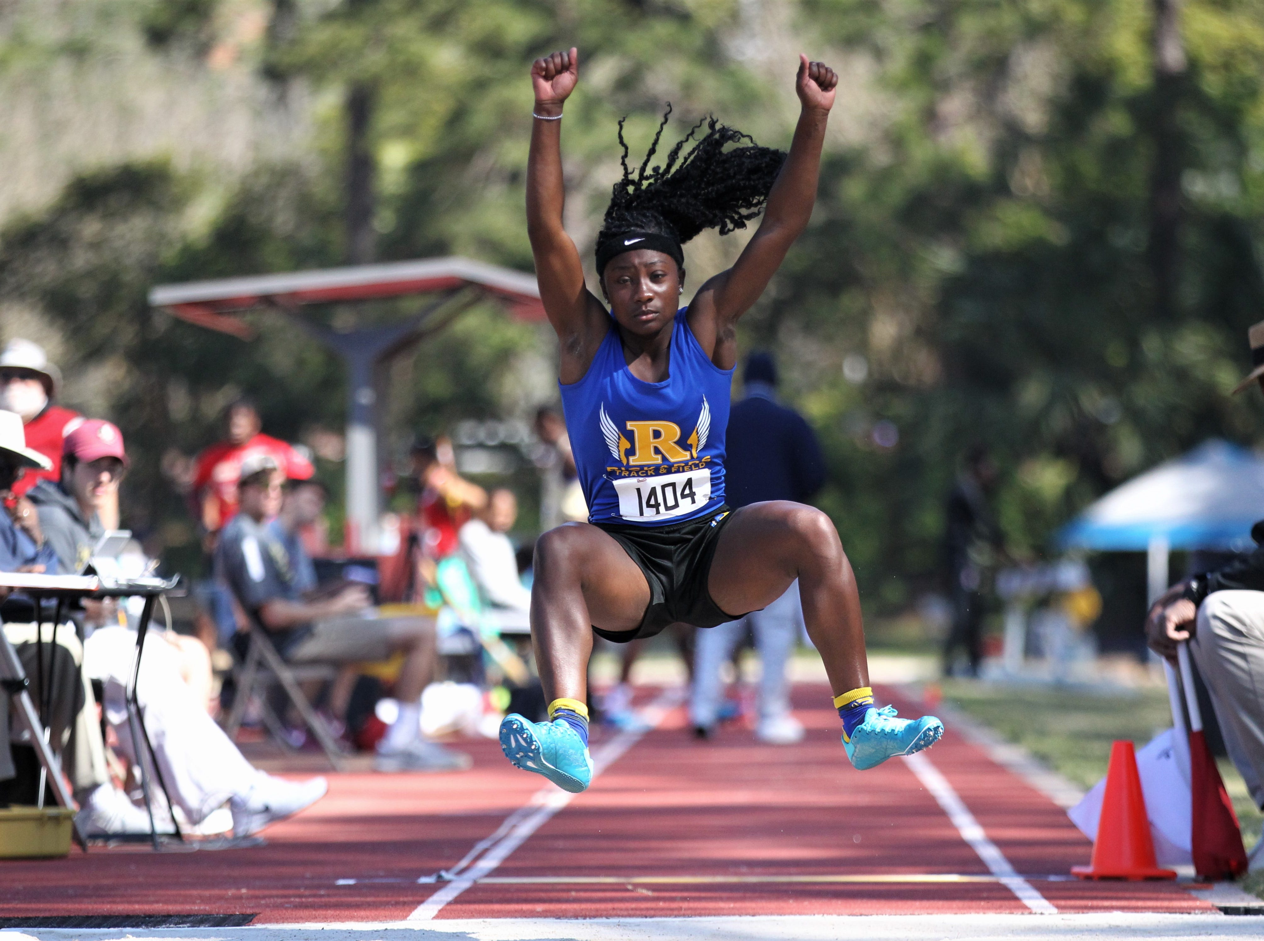Rickards senior Heaven Haynes long jumps during the 40th annual FSU Relays at Mike Long Track on Saturday, March 23, 2019.