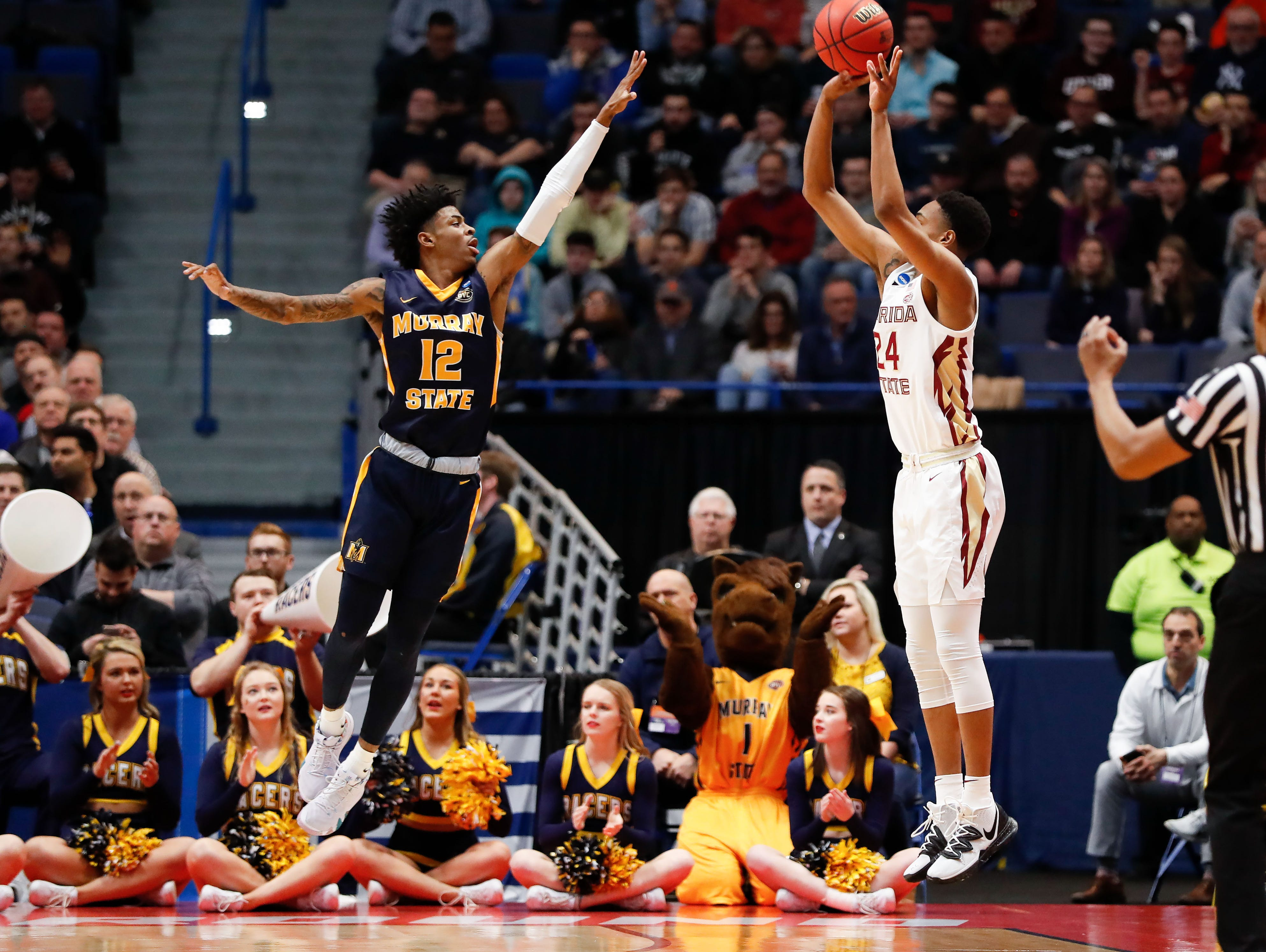 Mar 23, 2019; Hartford, CT, USA; Florida State Seminoles guard Devin Vassell (24) attempts a three point basket over Murray State Racers guard Ja Morant (12) during the first half of a game in the second round of the 2019 NCAA Tournament at XL Center. Mandatory Credit: David Butler II-USA TODAY Sports