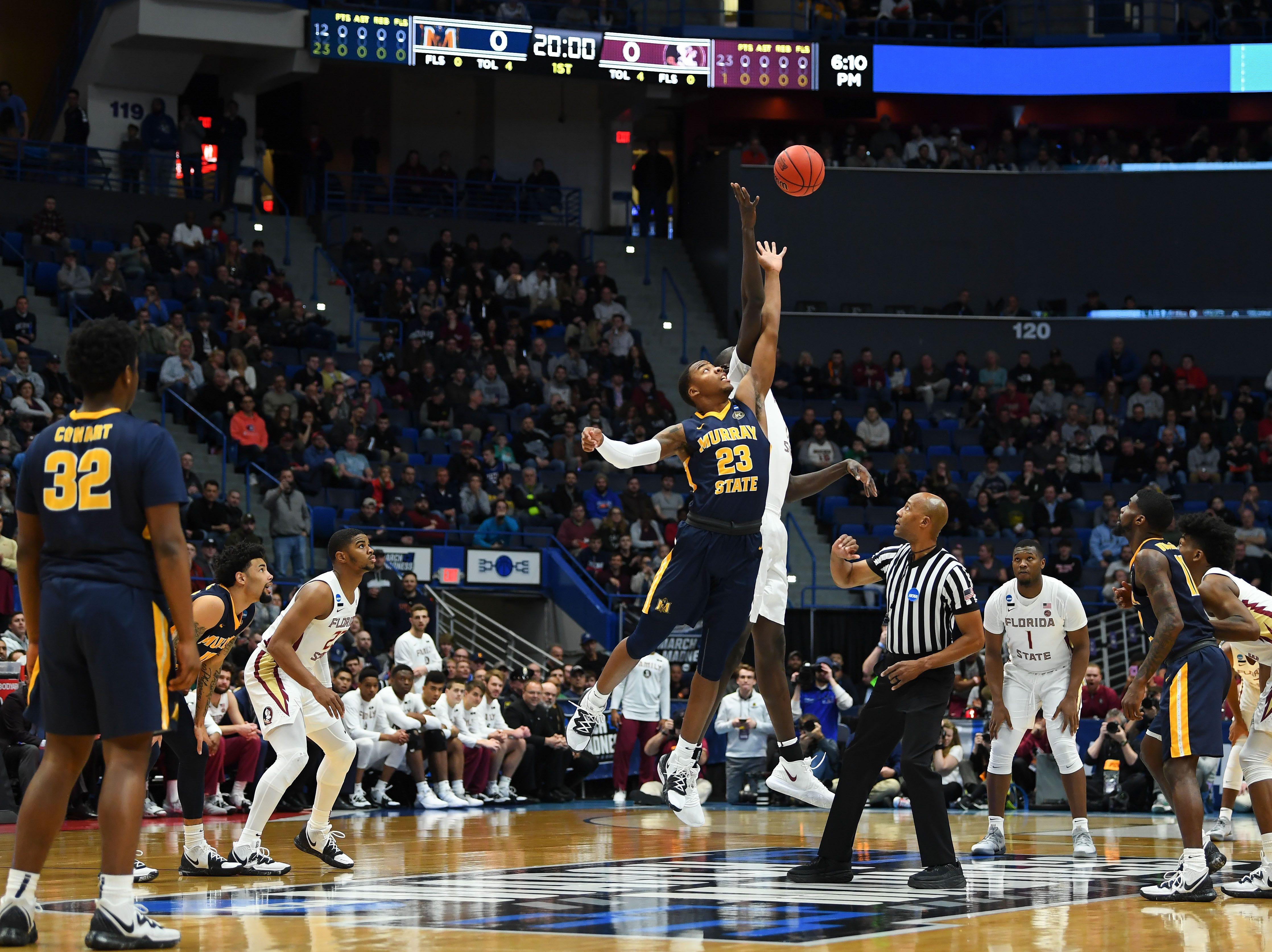 Mar 23, 2019; Hartford, CT, USA; Florida State Seminoles center Christ Koumadje (21) and Murray State Racers forward KJ Williams (23) reach for a jump ball to start a game in the second round of the 2019 NCAA Tournament at XL Center. Mandatory Credit: Robert Deutsch-USA TODAY Sports