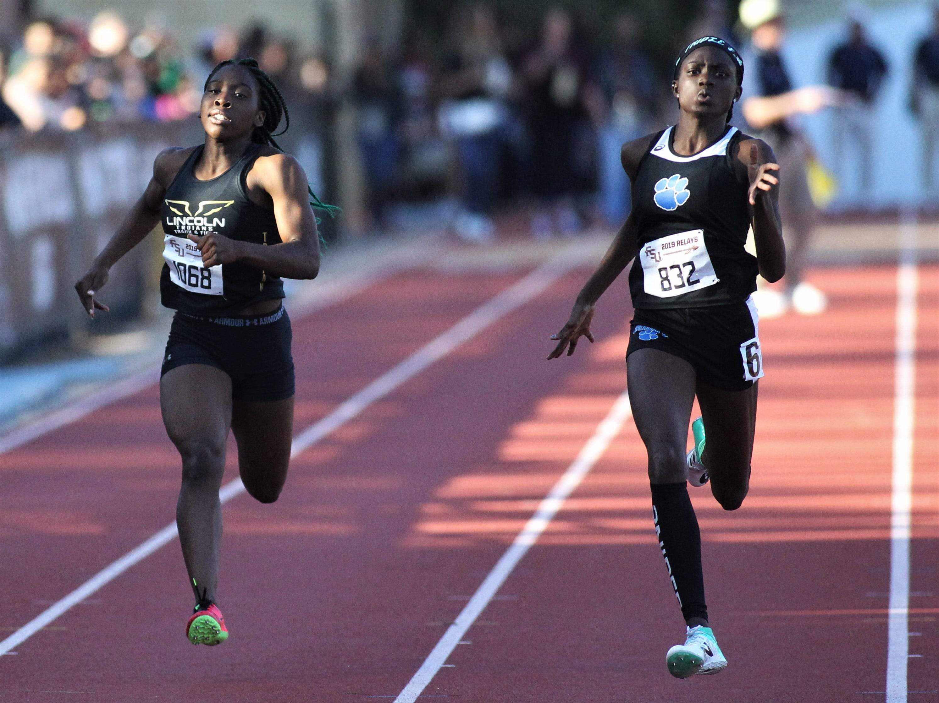 Lincoln sophomore Miahna Harden and Godby sophomore Naveyh Frost run the 200-meter dash during the 40th annual FSU Relays at Mike Long Track on Friday, March 22, 2019.