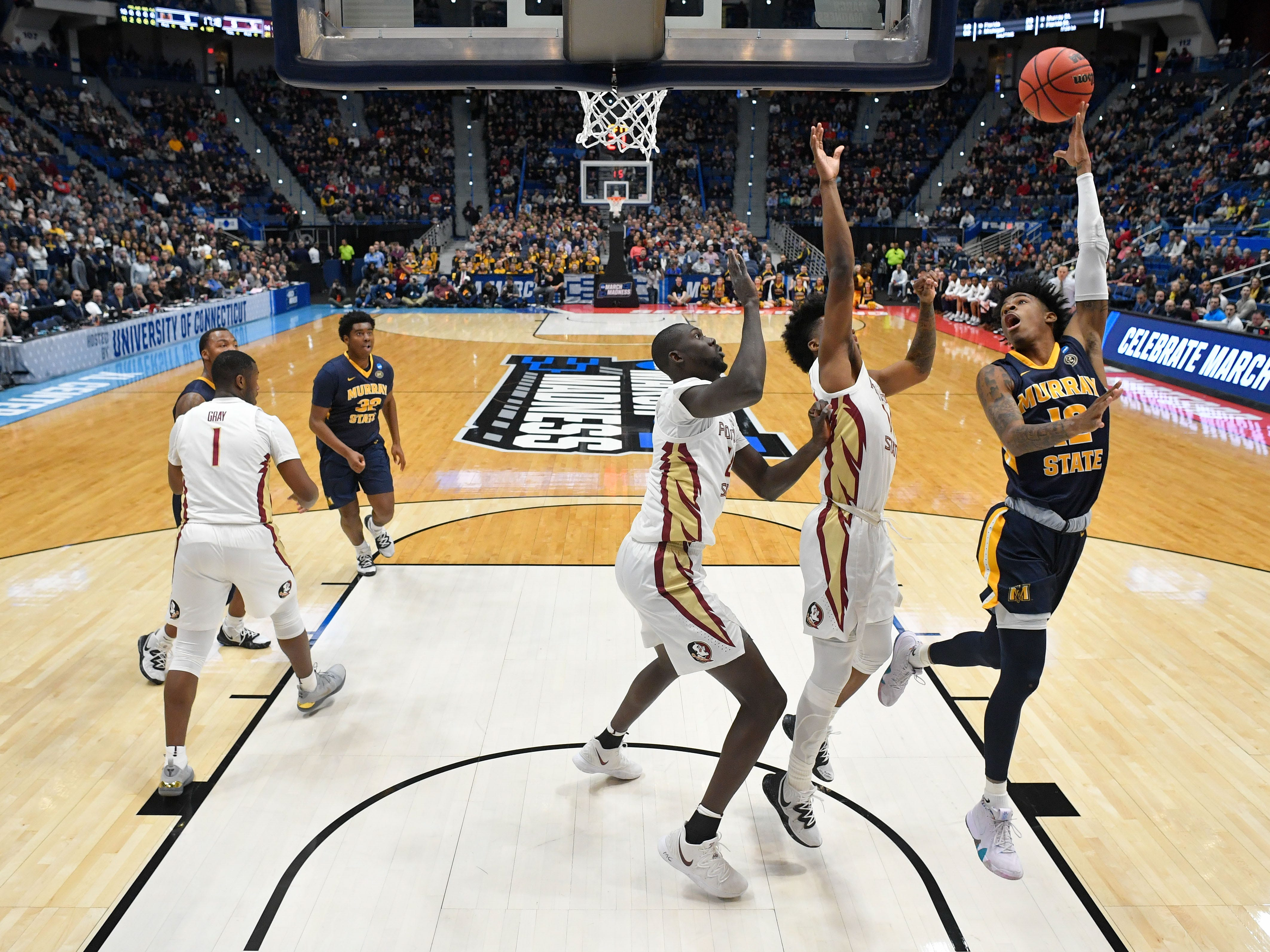 Mar 23, 2019; Hartford, CT, USA; Murray State Racers guard Ja Morant (12) attempts a layup against the Florida State Seminoles during the first half of a game in the second round of the 2019 NCAA Tournament at XL Center. Mandatory Credit: David Butler II-USA TODAY Sports