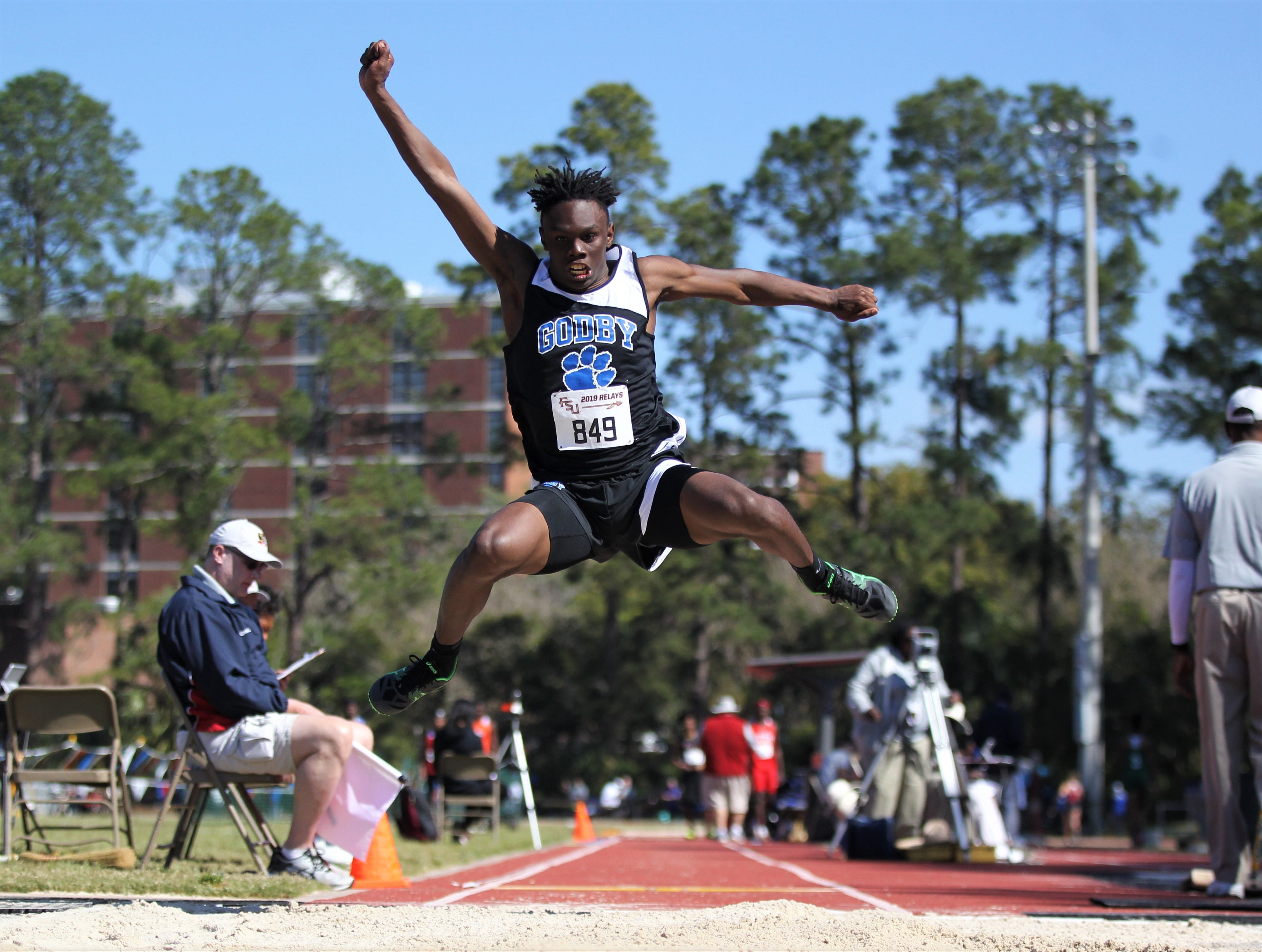 Godby junior Deshawn Rucker long jumps during the 40th annual FSU Relays at Mike Long Track on Saturday, March 23, 2019.