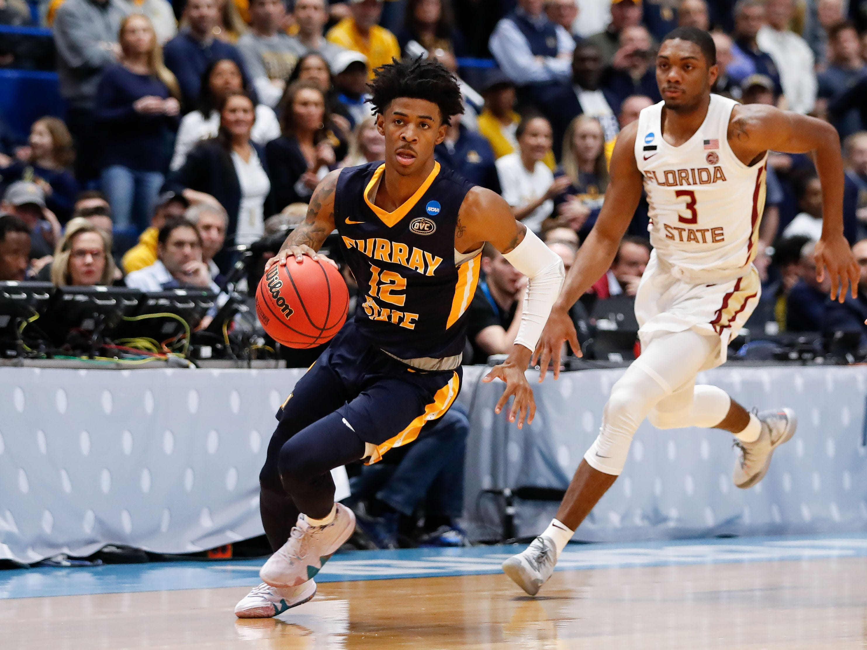 Mar 23, 2019; Hartford, CT, USA; Murray State Racers guard Ja Morant (12) dribbles the ball up the court in front of Florida State Seminoles guard Trent Forrest (3) during the first half of a game in the second round of the 2019 NCAA Tournament at XL Center. Mandatory Credit: David Butler II-USA TODAY Sports