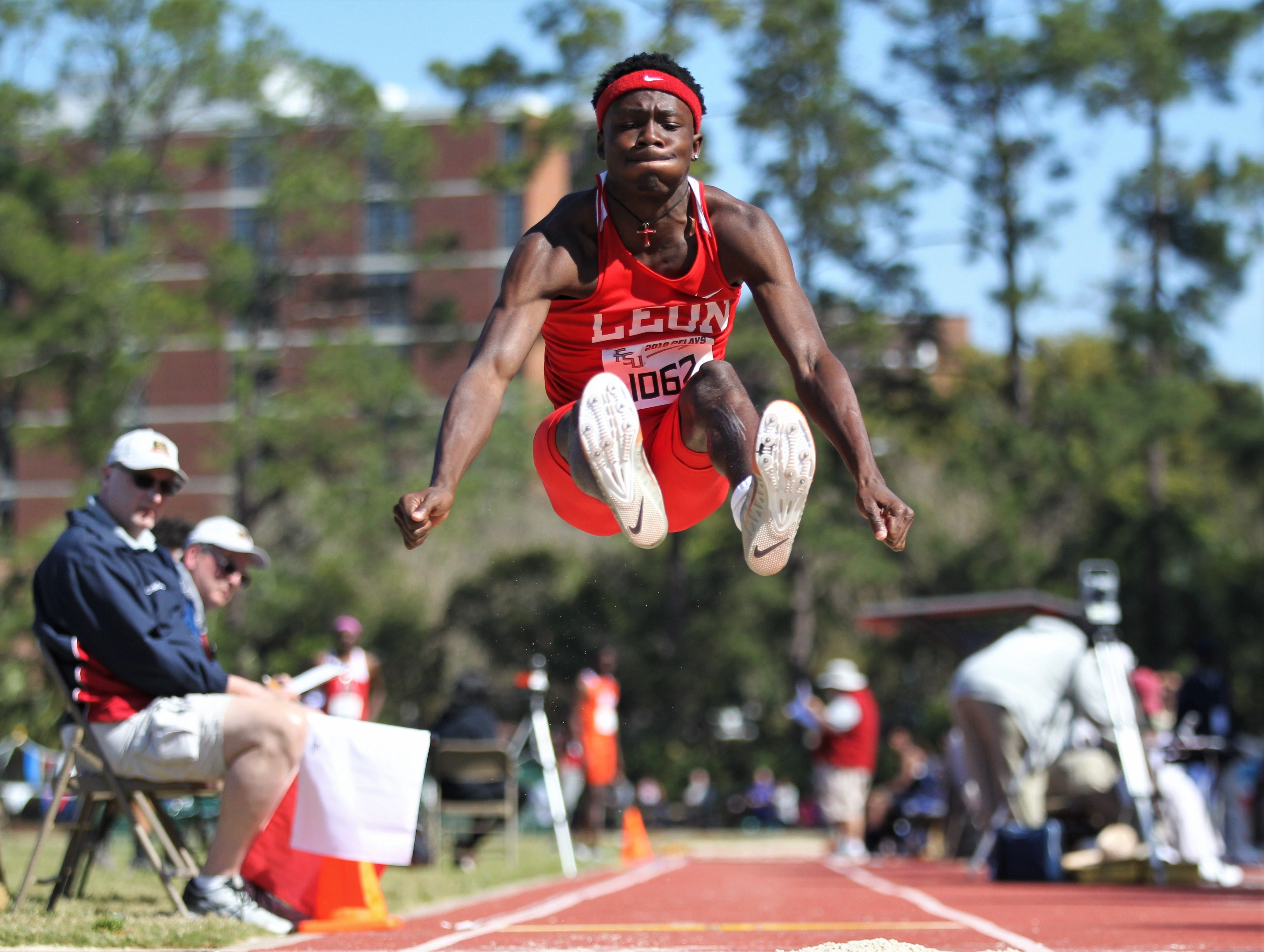 Leon sophomore Curtis Williams long jumps during the 40th annual FSU Relays at Mike Long Track on Saturday, March 23, 2019.