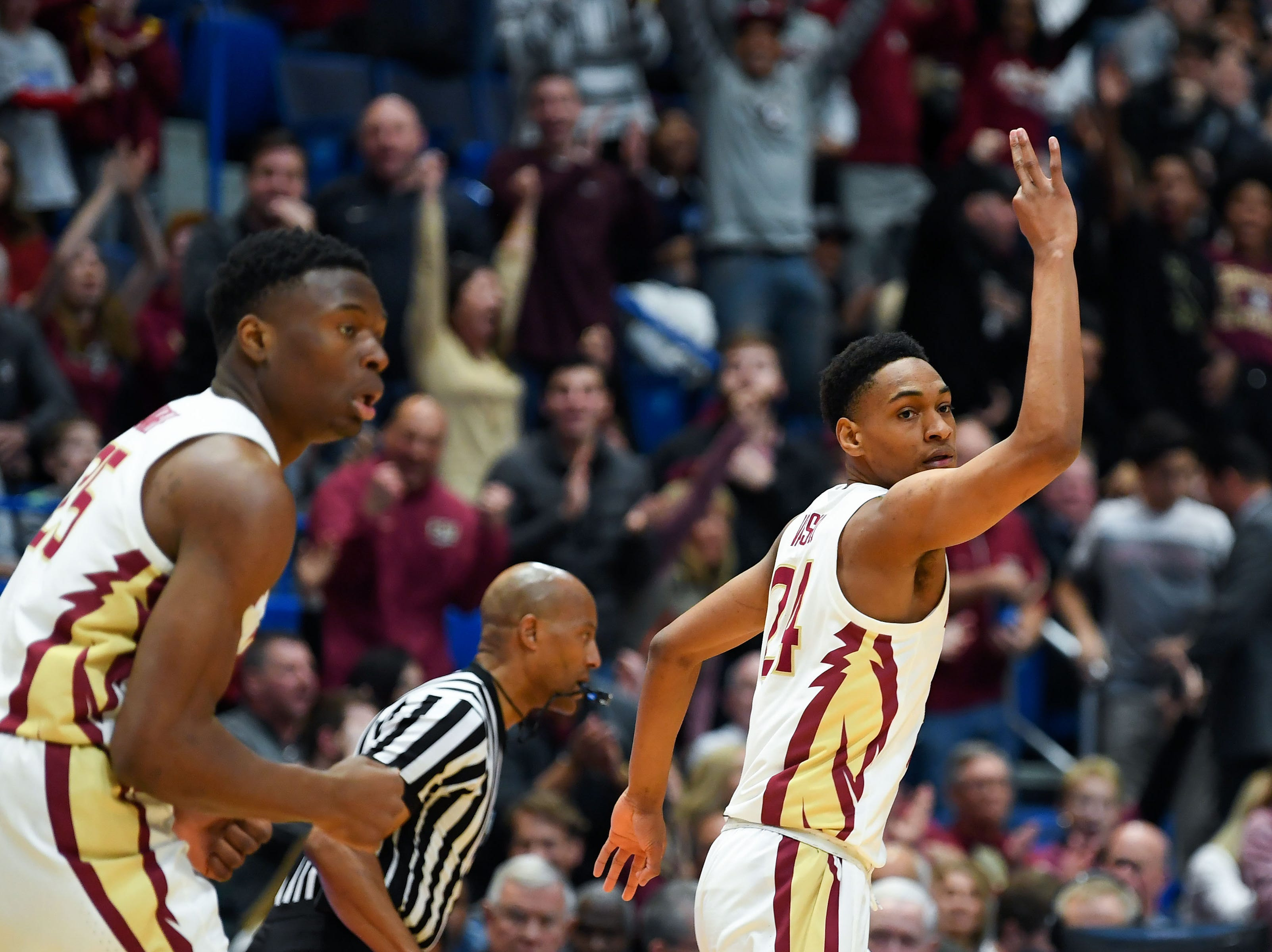 Mar 23, 2019; Hartford, CT, USA; Florida State Seminoles guard Devin Vassell (24) reacts after a score against the Murray State Racers during the first half of a game in the second round of the 2019 NCAA Tournament at XL Center. Mandatory Credit: Robert Deutsch-USA TODAY Sports