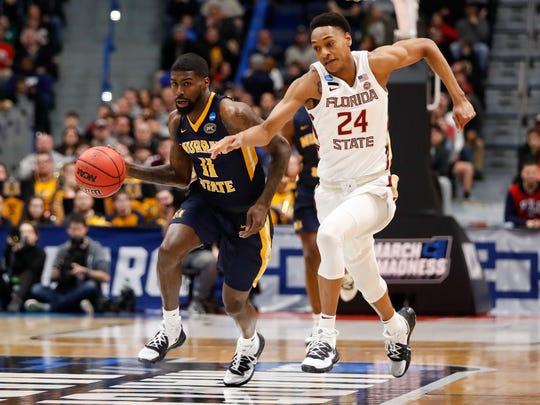 Mar 23, 2019; Hartford, CT, USA; Murray State Racers guard Shaq Buchanan (11) dribbles the ball against Florida State Seminoles guard Devin Vassell (24) during the first half of a game in the second round of the 2019 NCAA Tournament at XL Center. Mandatory Credit: David Butler II-USA TODAY Sports