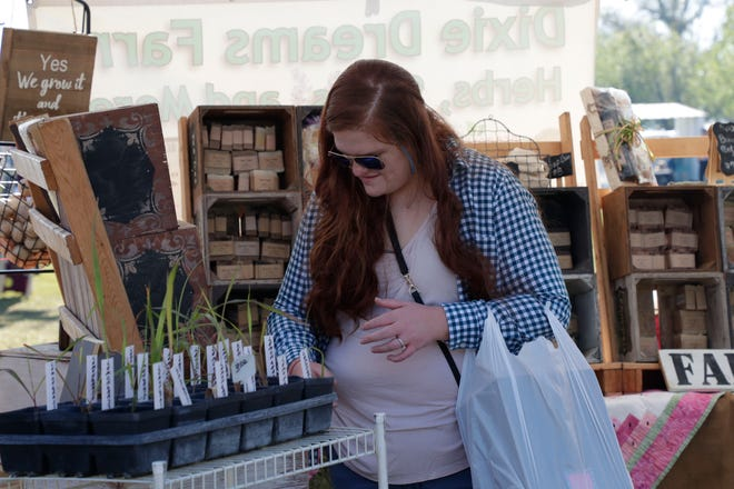 Lauren Beckwith shops for soap at the French Country Flea  Market Saturday, March 23, 2019.
