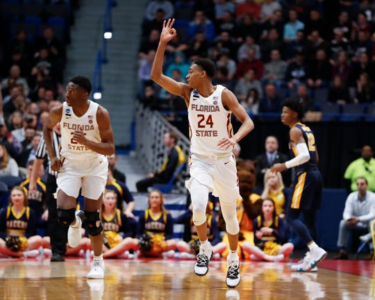 Mar 23, 2019; Hartford, CT, USA; Florida State Seminoles guard Devin Vassell (24) reacts after a score against the Murray State Racers during the first half of a game in the second round of the 2019 NCAA Tournament at XL Center. Mandatory Credit: David Butler II-USA TODAY Sports