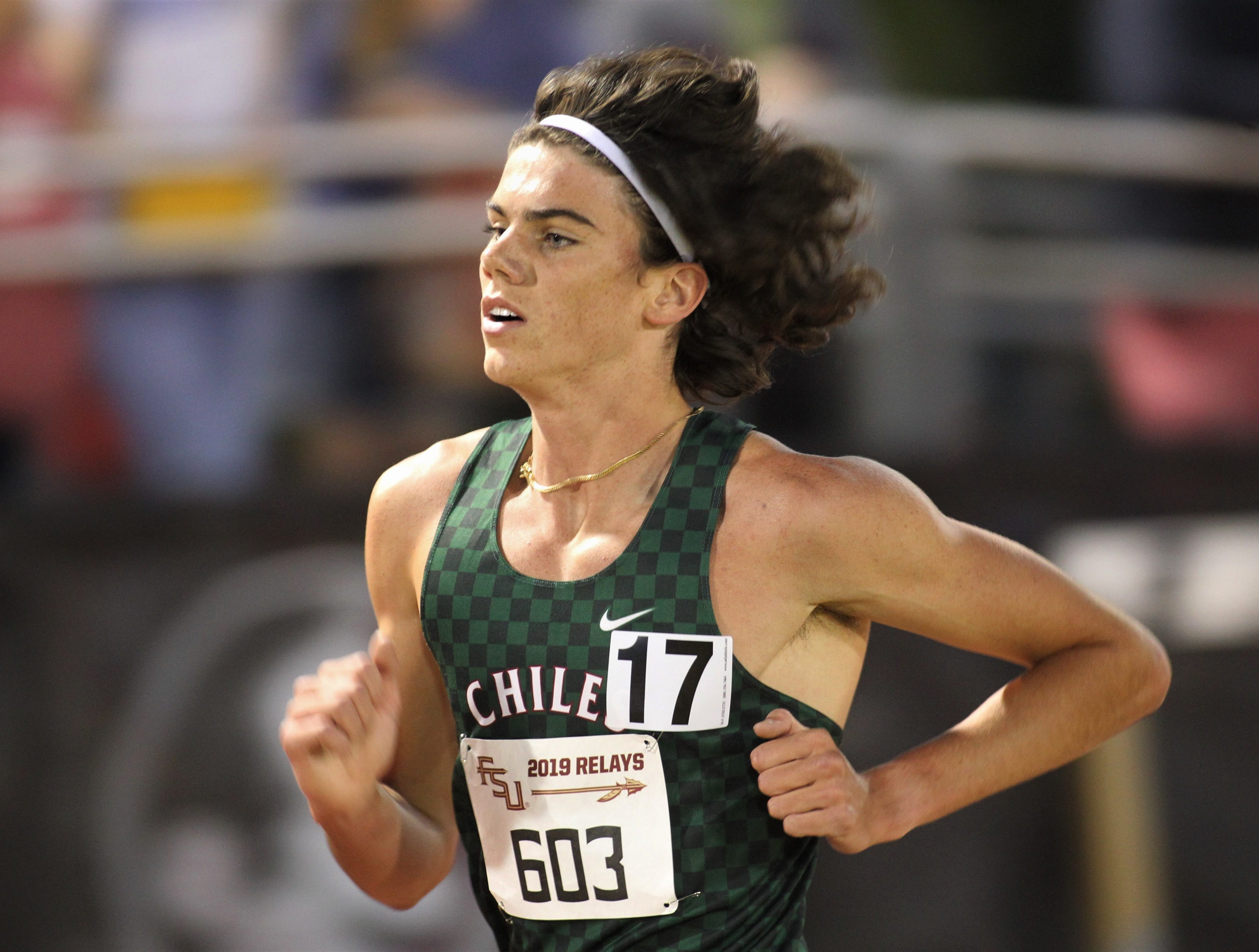 Chiles senior Connor Phillips competes in the 3200-meter invitational race during the 40th annual FSU Relays at Mike Long Track on Friday night, March 22, 2019.