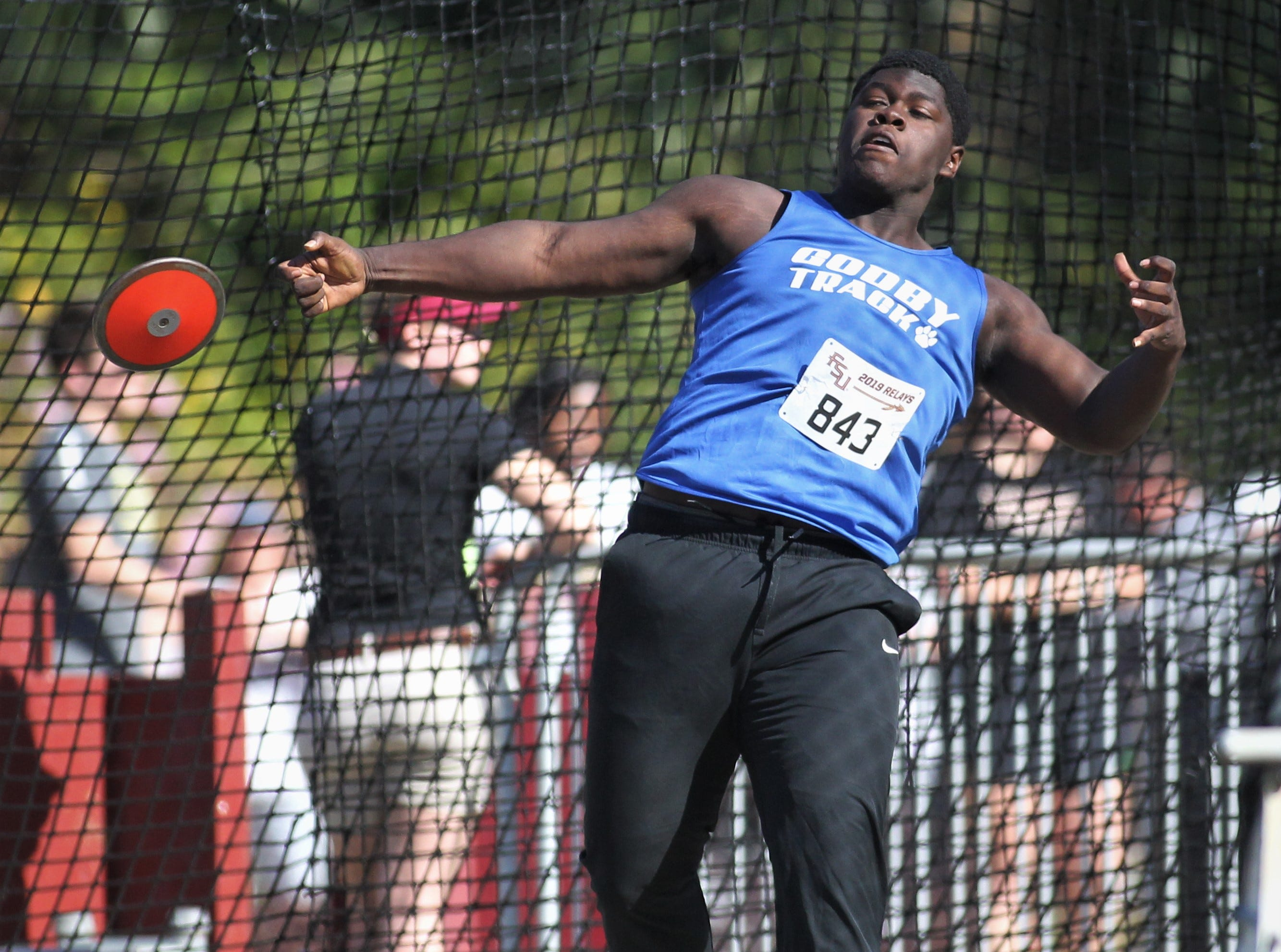 Godby junior Michael Brown throws discus during the 40th annual FSU Relays at Mike Long Track on Saturday, March 23, 2019.