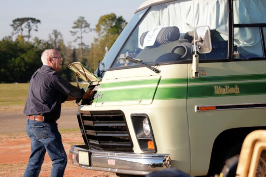 Ken Henderson helps a friend get their GMC motorhome up and running. The GMC Motorhomes International hosts their 2019 Spring Convention at the North Florida Fairgrounds Saturday, March 23, 2019.