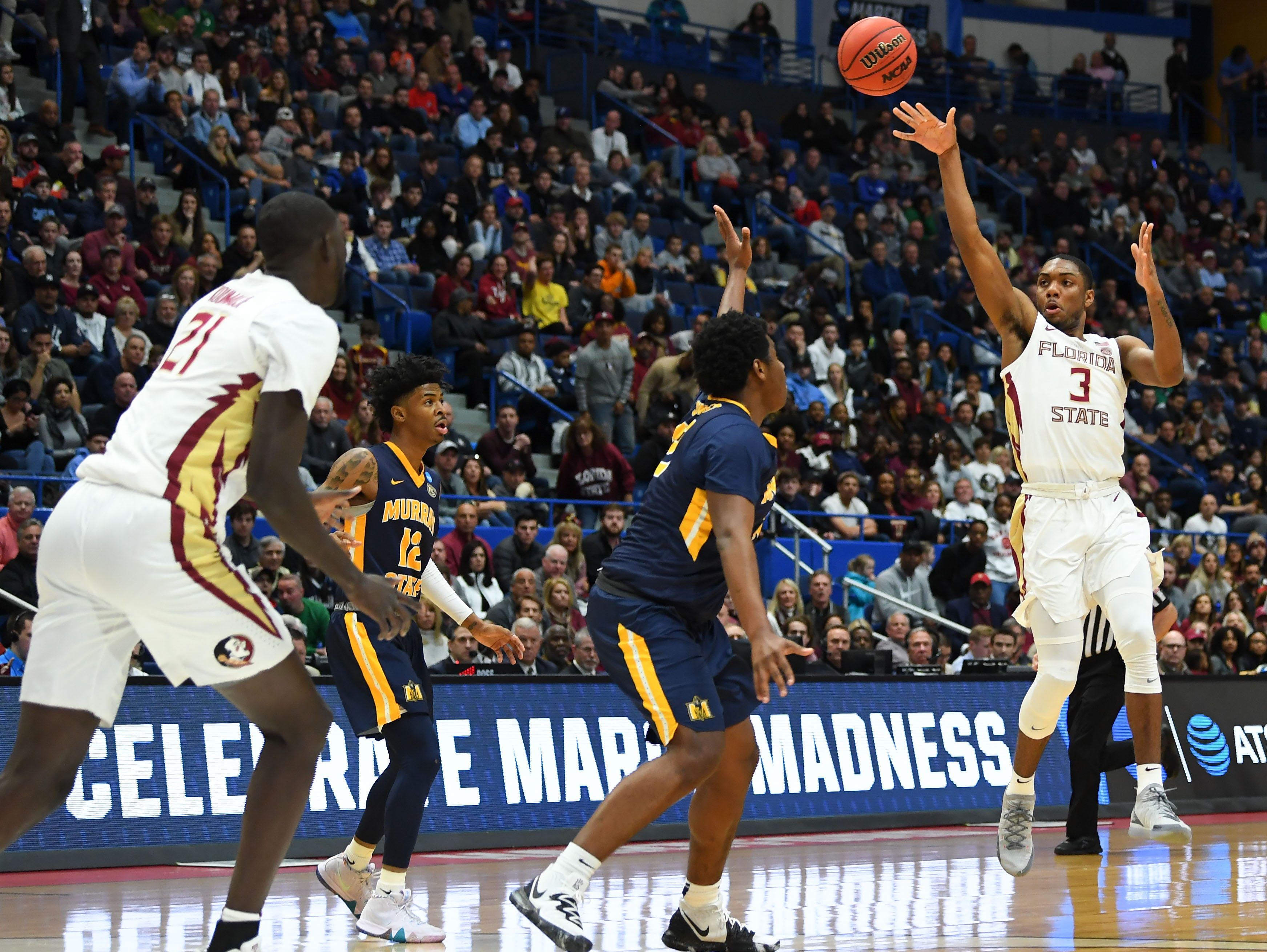 Mar 23, 2019; Hartford, CT, USA; Florida State Seminoles guard Trent Forrest (3) passes the ball against the Murray State Racers during the first half of a game in the second round of the 2019 NCAA Tournament at XL Center. Mandatory Credit: Robert Deutsch-USA TODAY Sports