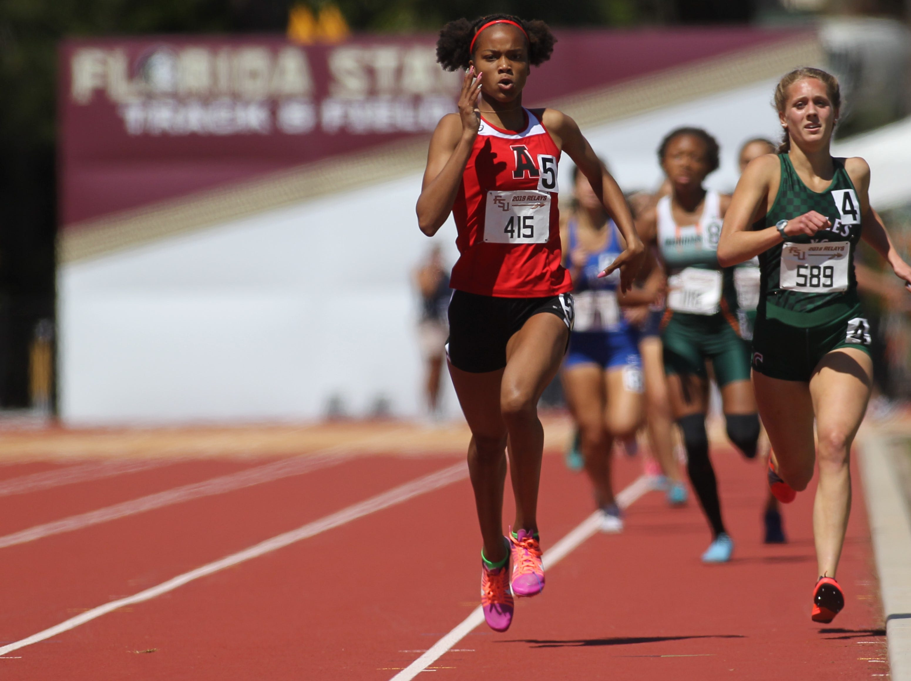 Chiles junior Caitlin Wilkey tries to catch Alexander's Jazzmin Taylor on the final stretch of the 800-meter run during the FSU Relays at Mike Long Track on Friday, March 22, 2019.