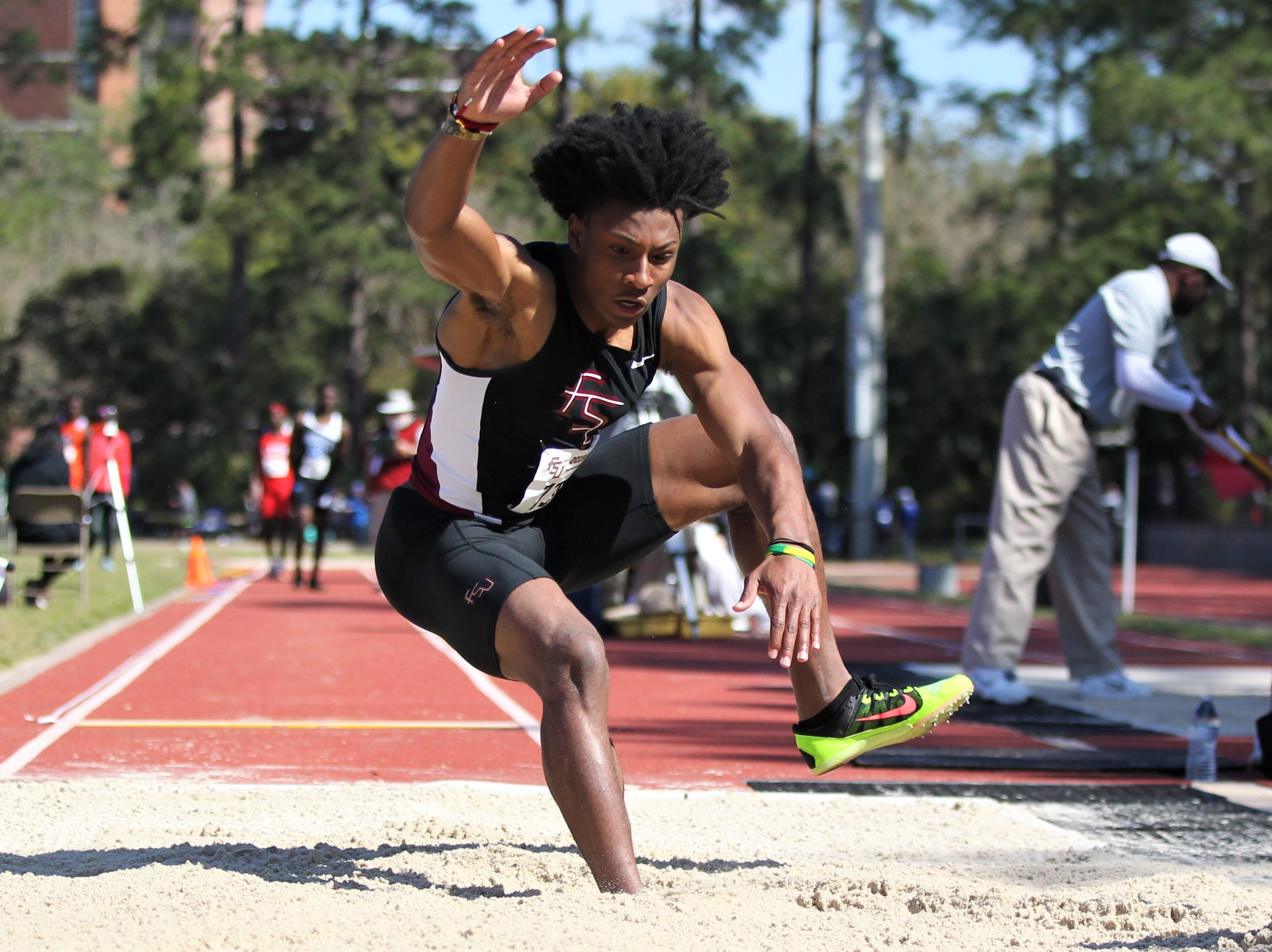 Florida High senior Javan Morgan long jumps during the 40th annual FSU Relays at Mike Long Track on Saturday, March 23, 2019.