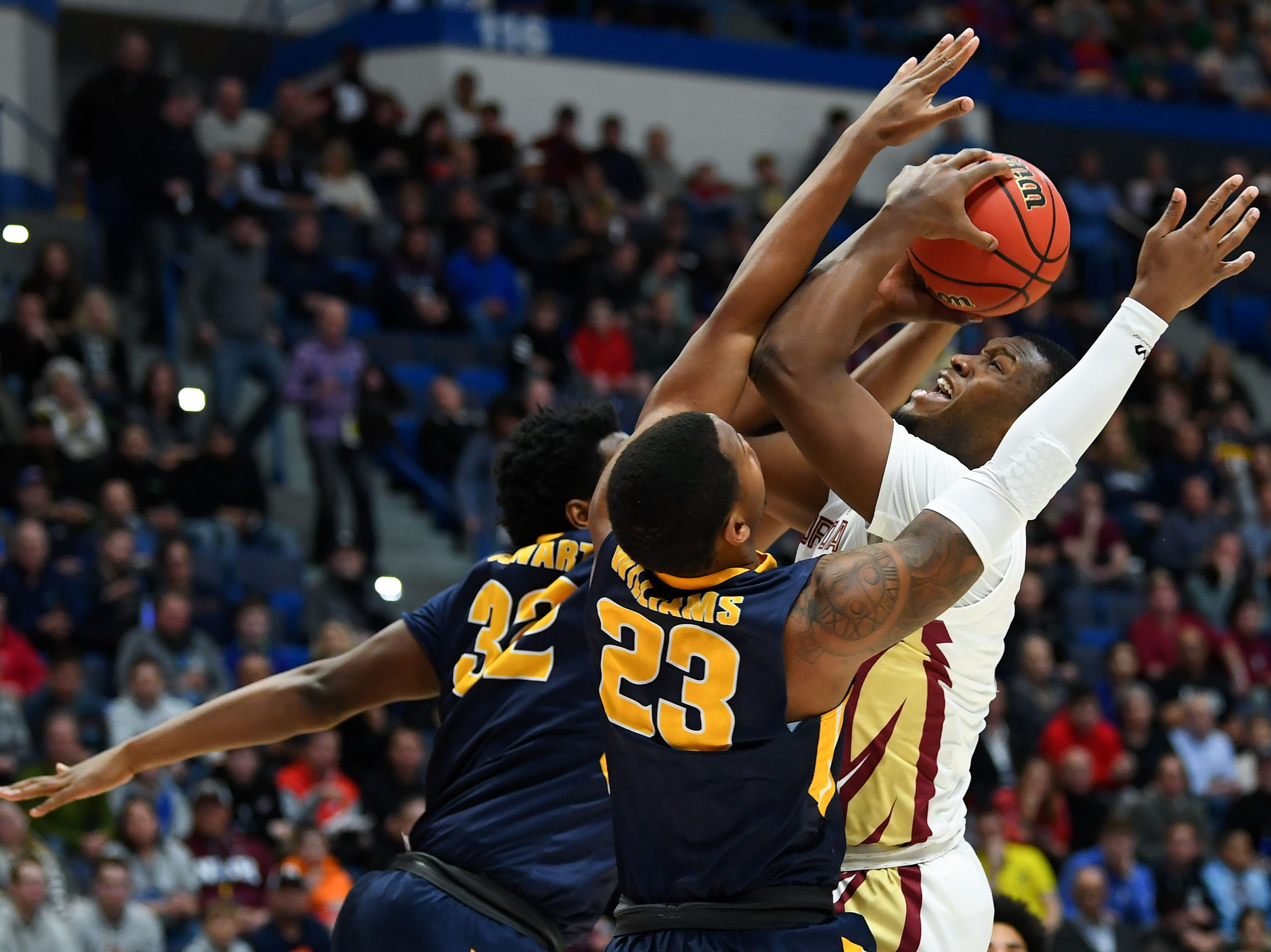 Mar 23, 2019; Hartford, CT, USA; Murray State Racers forward Darnell Cowart (32) and forward KJ Williams (23) defend Florida State Seminoles forward Raiquan Gray (1) during the first half of a game in the second round of the 2019 NCAA Tournament at XL Center. Mandatory Credit: Robert Deutsch-USA TODAY Sports
