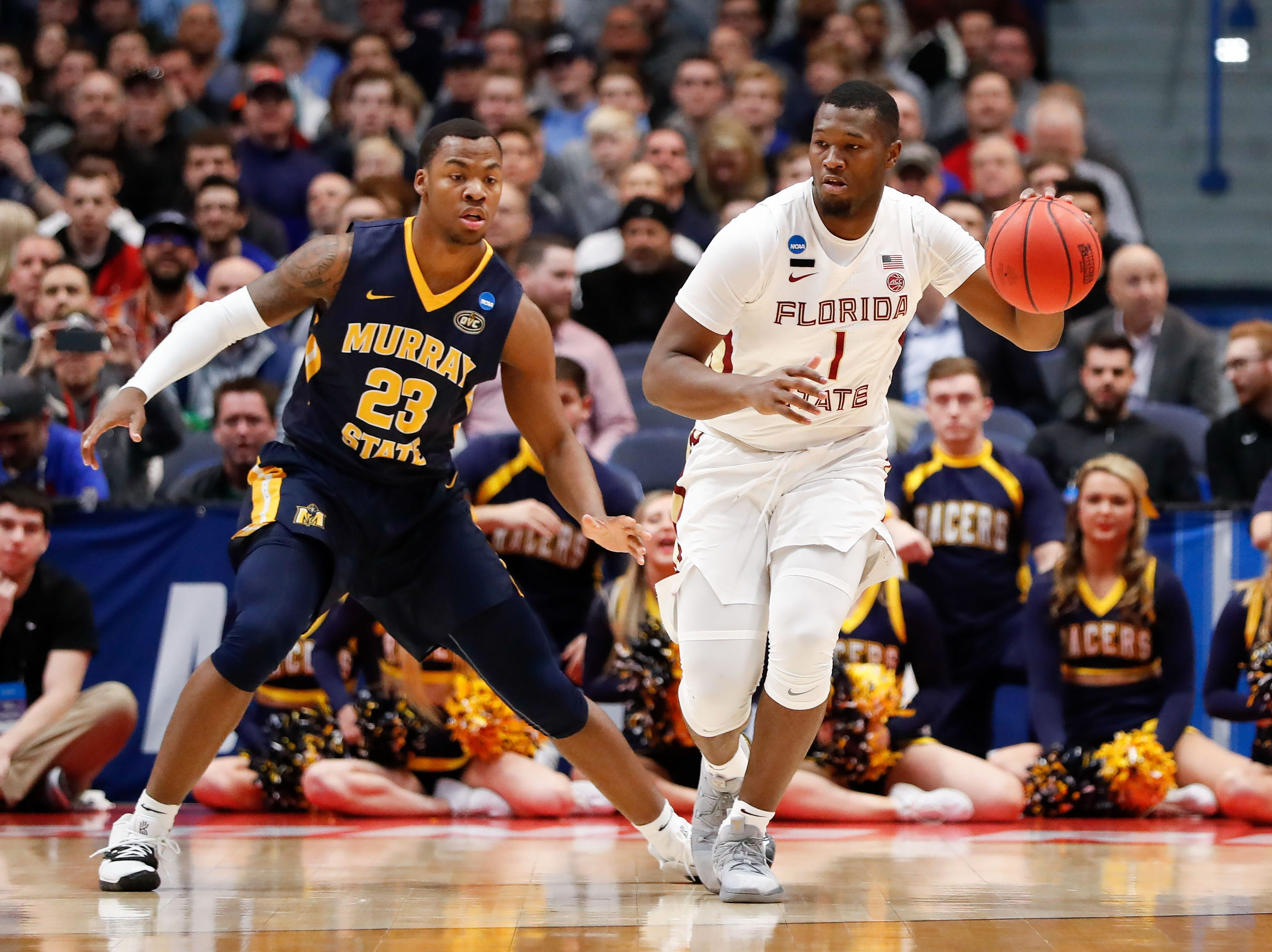 Mar 23, 2019; Hartford, CT, USA; Florida State Seminoles forward Raiquan Gray (1) controls the ball in front of Murray State Racers forward KJ Williams (23) during the first half of a game in the second round of the 2019 NCAA Tournament at XL Center. Mandatory Credit: David Butler II-USA TODAY Sports