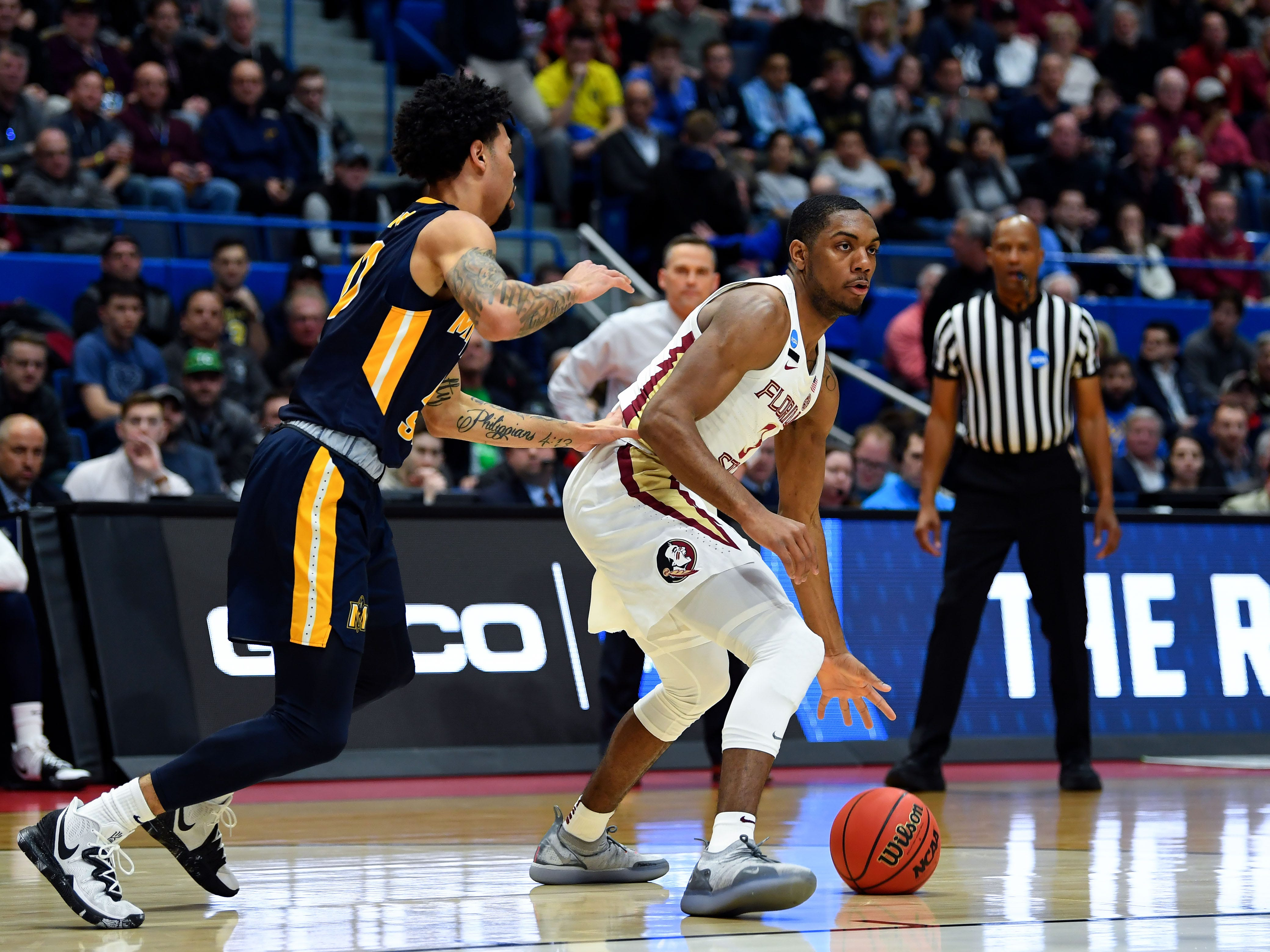 Mar 23, 2019; Hartford, CT, USA; Florida State Seminoles guard Trent Forrest (3) controls the ball against Murray State Racers guard Tevin Brown (10) during the first half of a game in the second round of the 2019 NCAA Tournament at XL Center. Mandatory Credit: Robert Deutsch-USA TODAY Sports