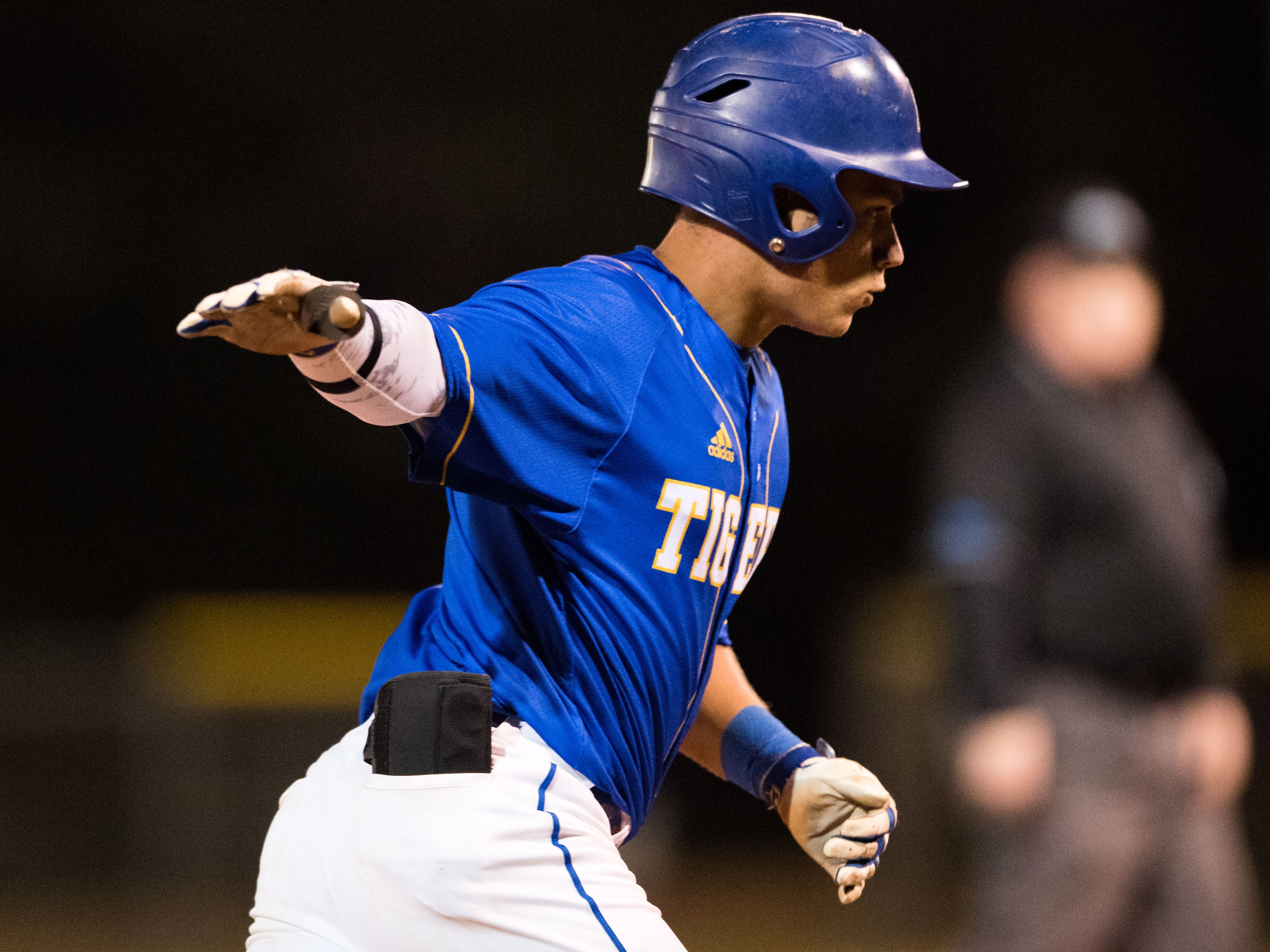 Martin County's Brannon Mondragon rounds the bases after hitting a solo homer in the fifth inning against South Fork during the 2019 Robbie Souza Classic high school baseball game Friday, March 22, 2019, at South Fork High School in Tropical Farms. Martin County won, 5-1.