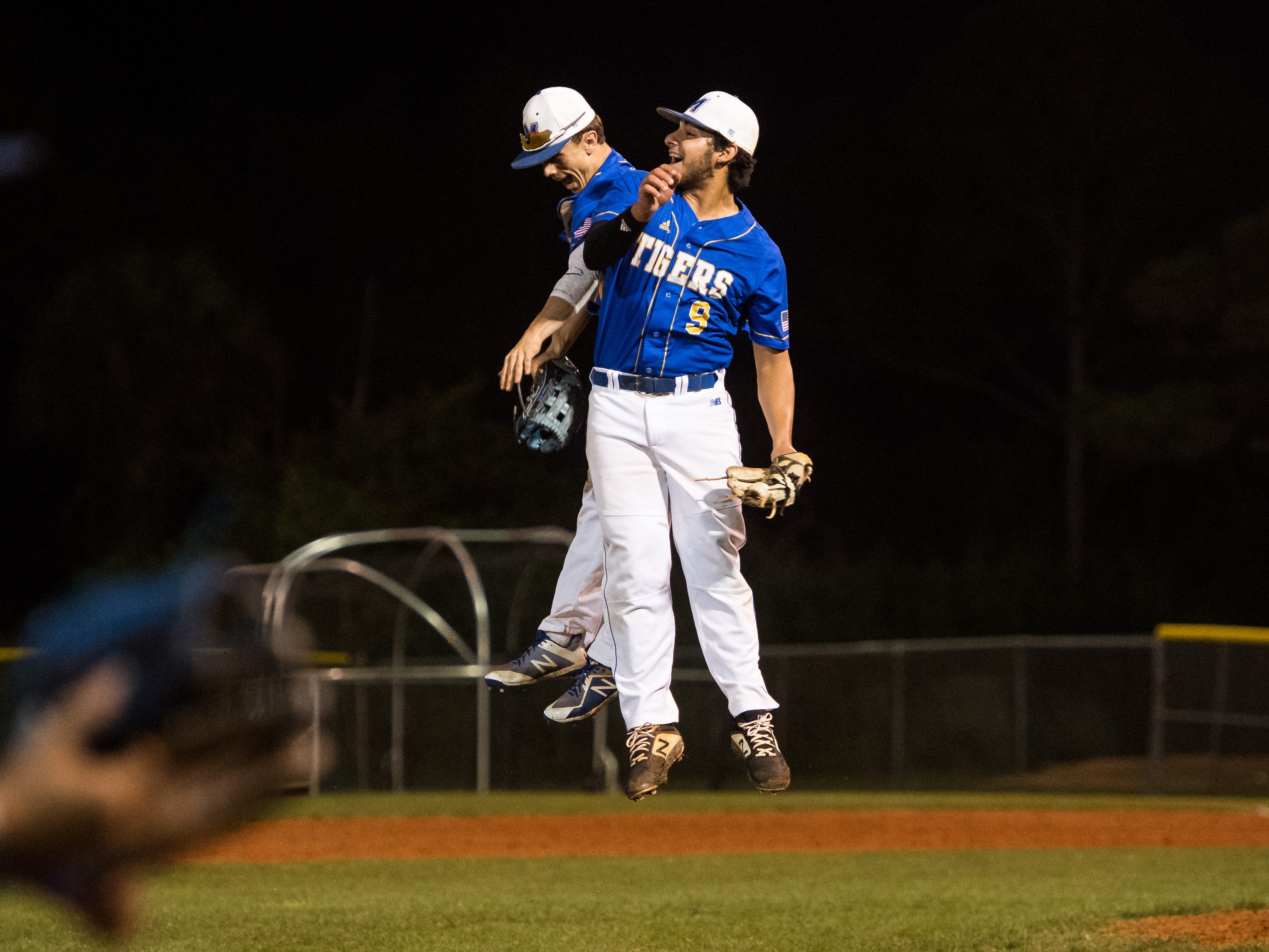 Martin County pitcher Tibur Rivero (right) celebrates with teammate Blake Pond after throwing the final strikeout to win 5-1 against South Fork during the 2019 Robbie Souza Classic high school baseball game Friday, March 22, 2019, at South Fork High School in Tropical Farms.