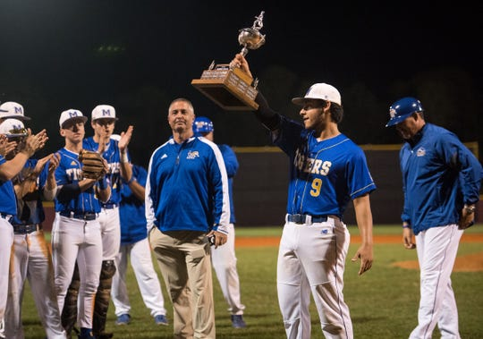 Martin County winning pitcher and game MVP Tibur Rivero hoists the rivalry trophy after beating South Fork 5-1 at the 2019 Robbie Souza Classic high school baseball game Friday, March 22, 2019, at South Fork High School in Tropical Farms.