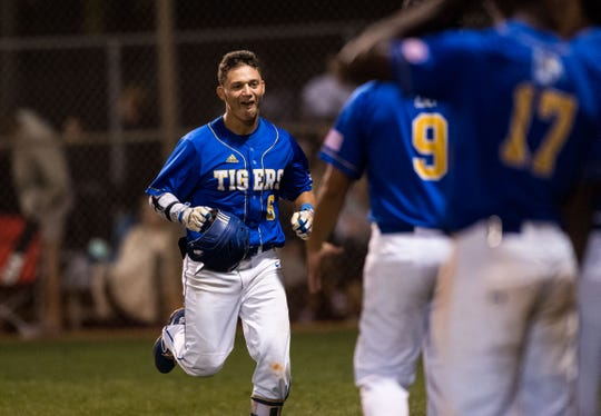 Martin County's Brannon Mondragon runs into an excited dugout after hitting a solo homer in the fifth inning against South Fork during the 2019 Robbie Souza Classic high school baseball game Friday, March 22, 2019, at South Fork High School in Tropical Farms. Martin County won, 5-1.
