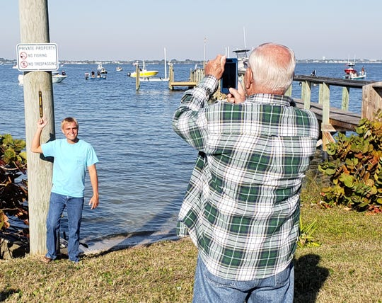 Scores of onlookers attended Saturday's Fish Joyce's Dock event on the Indian River Lagoon in Sebastian. The gathering, generated after a video of a conflict between a homeowner and a wade fisherman went viral on social media, was well-attended by boaters and bystanders alike.
