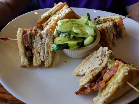 Mo-Bay Grill has a tasty chicken, blue cheese and bacon club sandwich with a small cucumber salad on the side.