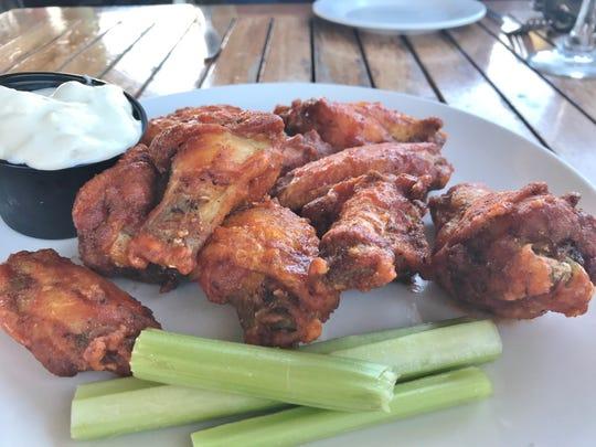 The jumbo sriracha wings were delicious, moist, and meaty.