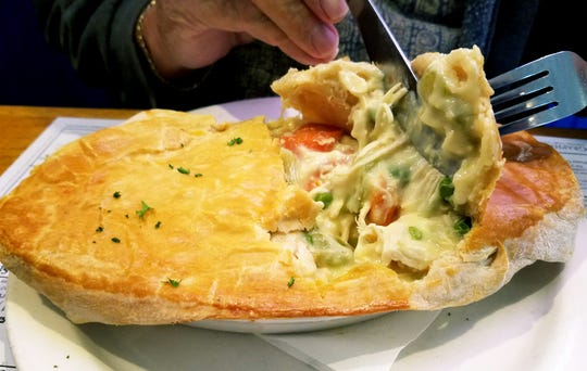 The chicken pot pie from the daily specials list was brimming with white meat chicken and fresh vegetables in gravy topped with a golden brown pastry crust.