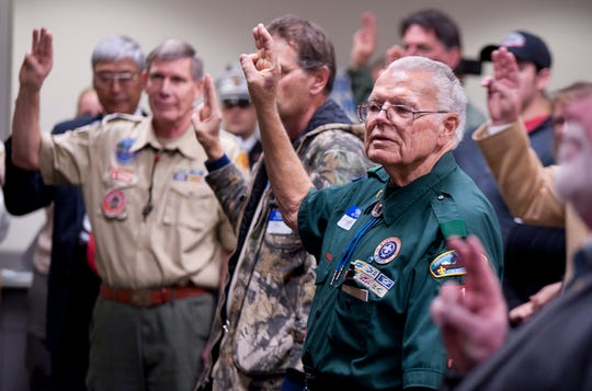 Bob Ludekens and others recite the Scout Oath and Law during a meeting Thursday, January 29, 2015 in Visalia to recruit more volunteers for Boy Scouts.