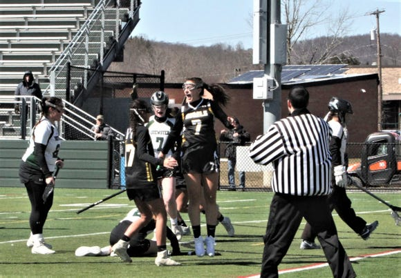 Keirra Ettere celebrates her game-tying goal for Lakeland/Panas vs. Brewster off an eight-meter shot with 1:13 left on March 23, 2019.